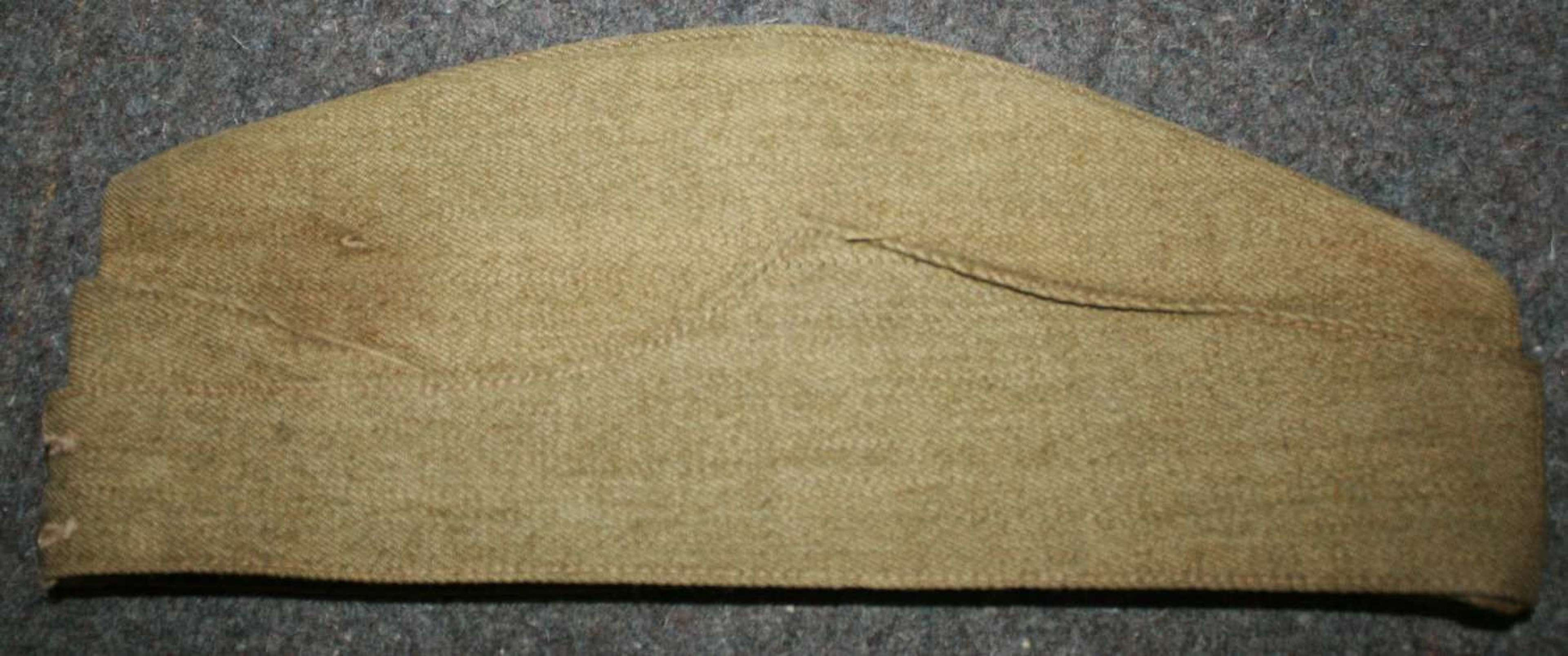 A 1943 DATED LIGHTLY USED SIZE 7 ARMY SIDE CAP