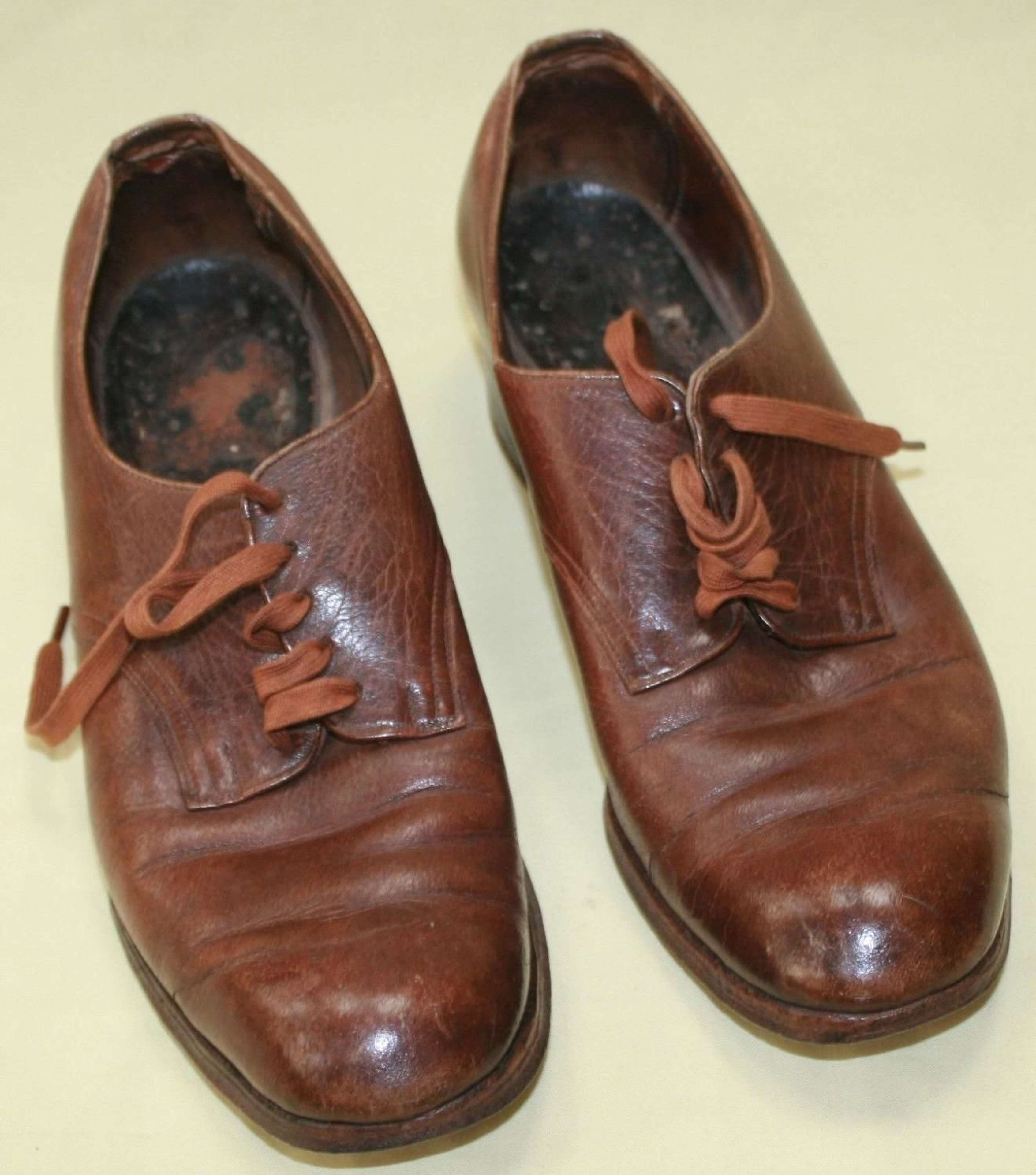 A PAIR OF ATS 1944 DATED SHOES