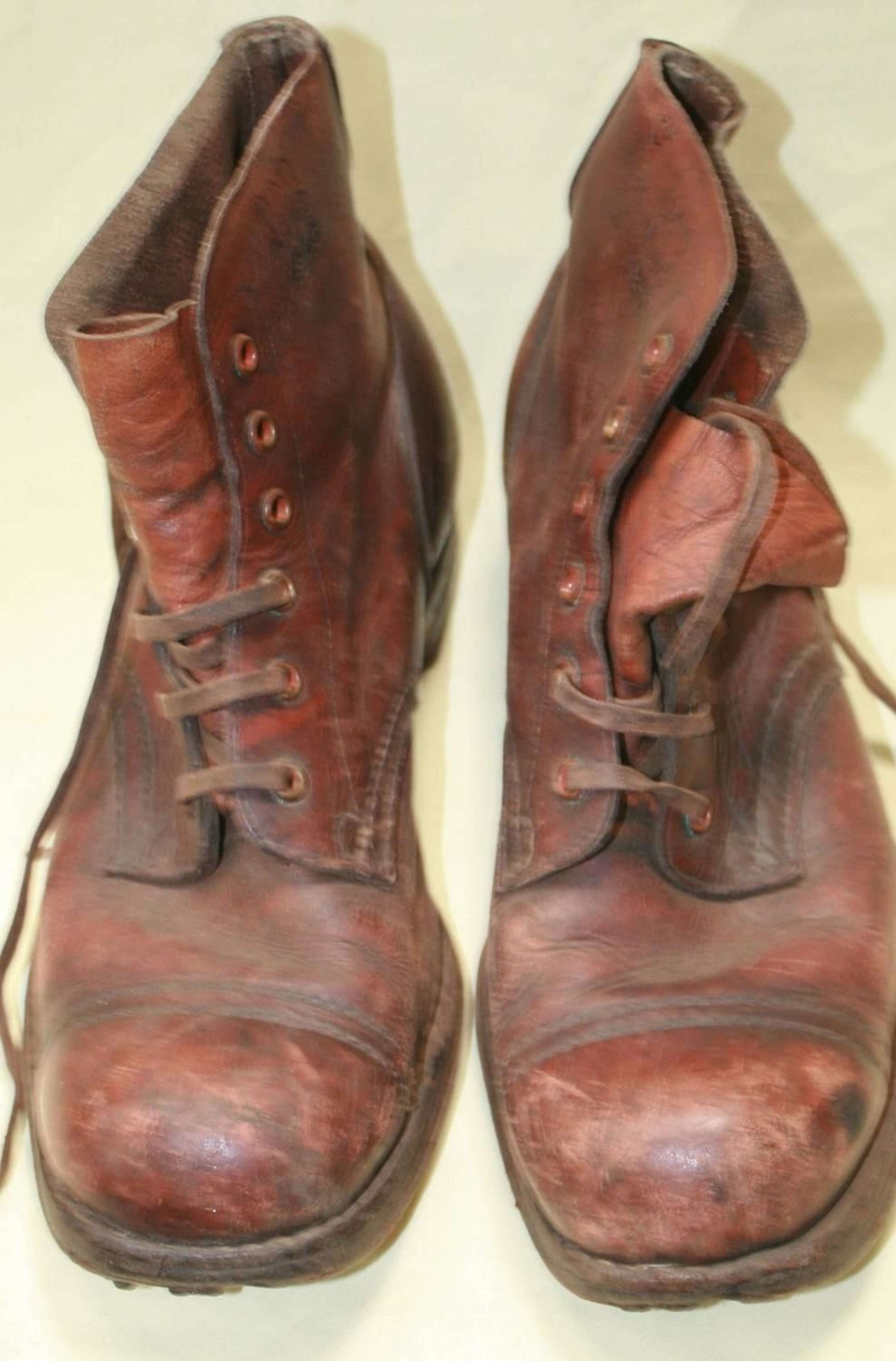 A PAIR OF AUSTRALIAN MADE 1945 DATED JUNGLE BOOTS WELL USED EXAMPLE