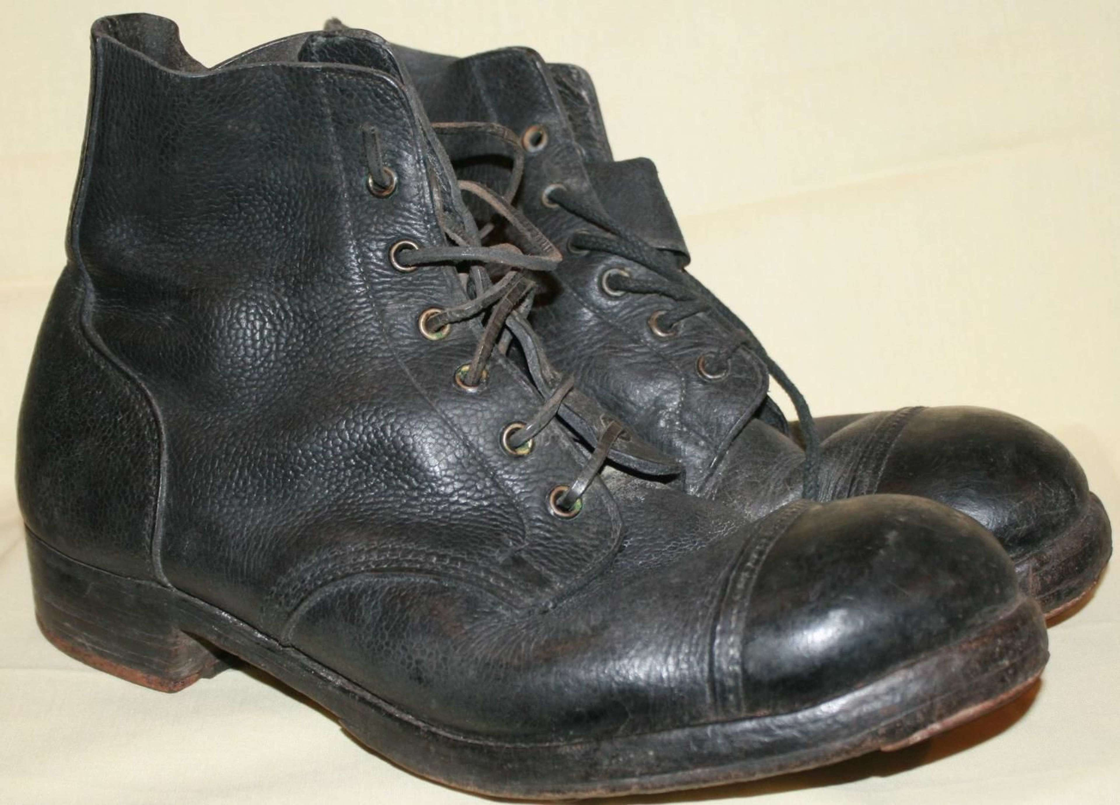 A PAIR OF BLACK HOBNAIL BOOTS 1942 DATED