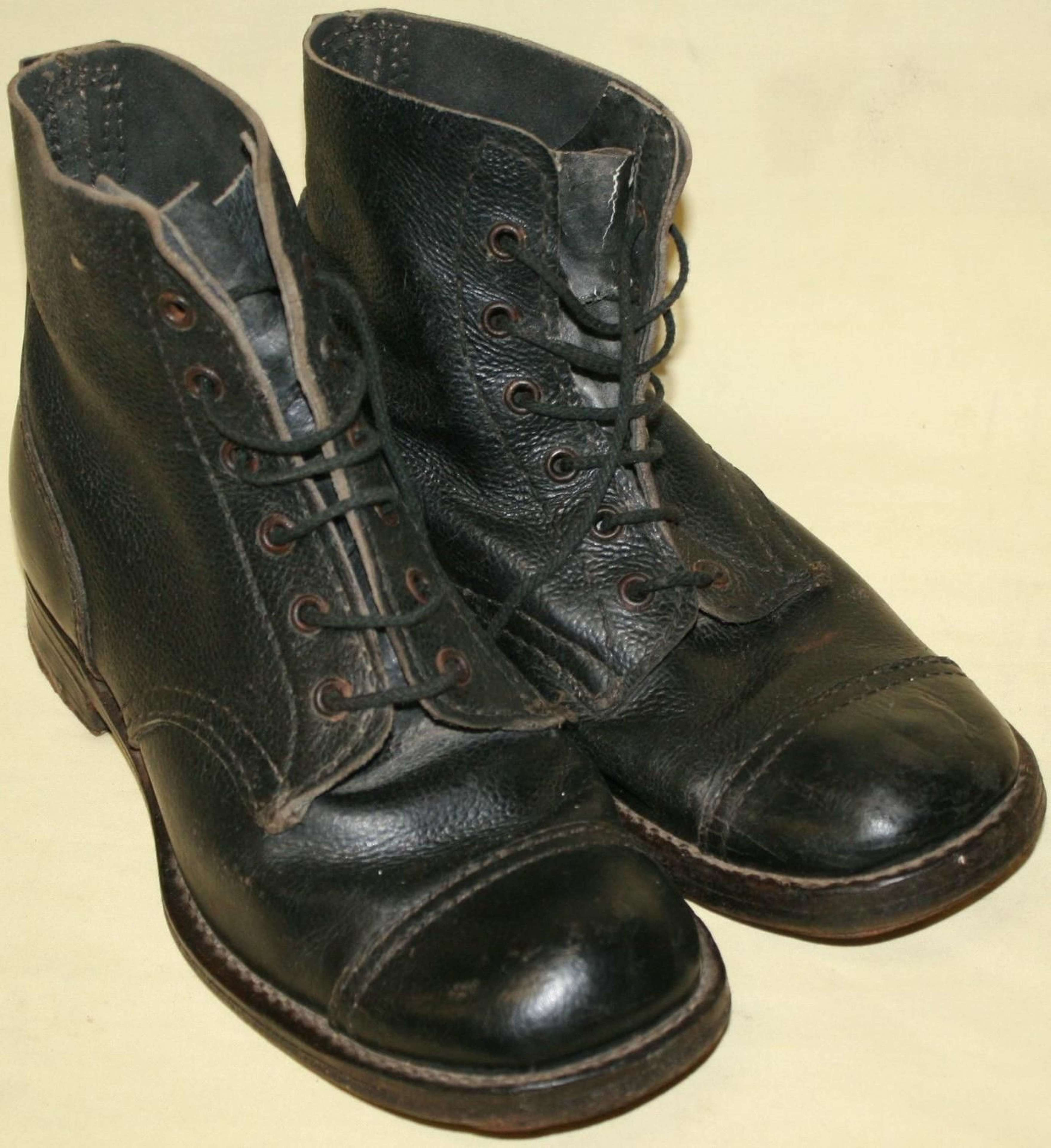 A PAIR OF SIZE 8 M 1944 DATED HOBNAIL BOOTS