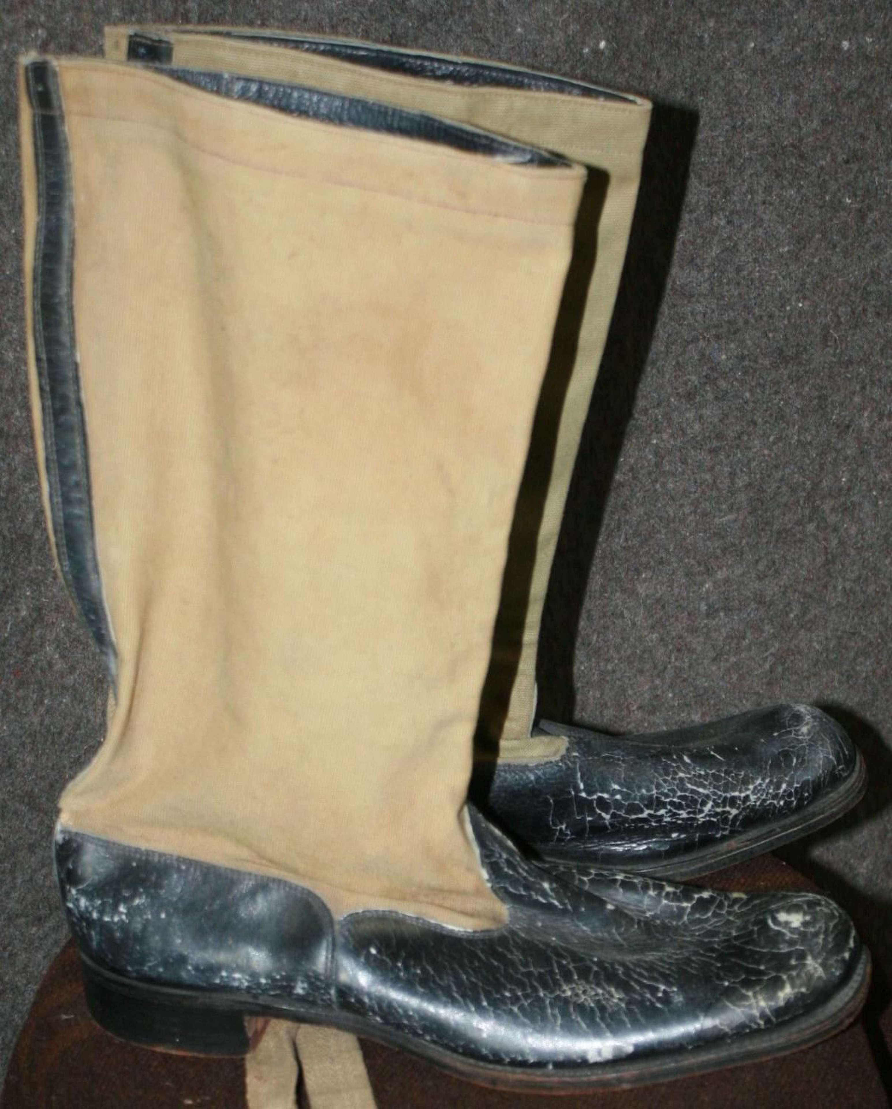 A PAIR OF THE RAF MOSQUITO BOOTS WHICH ARE 1945 DATED USED CONDITION