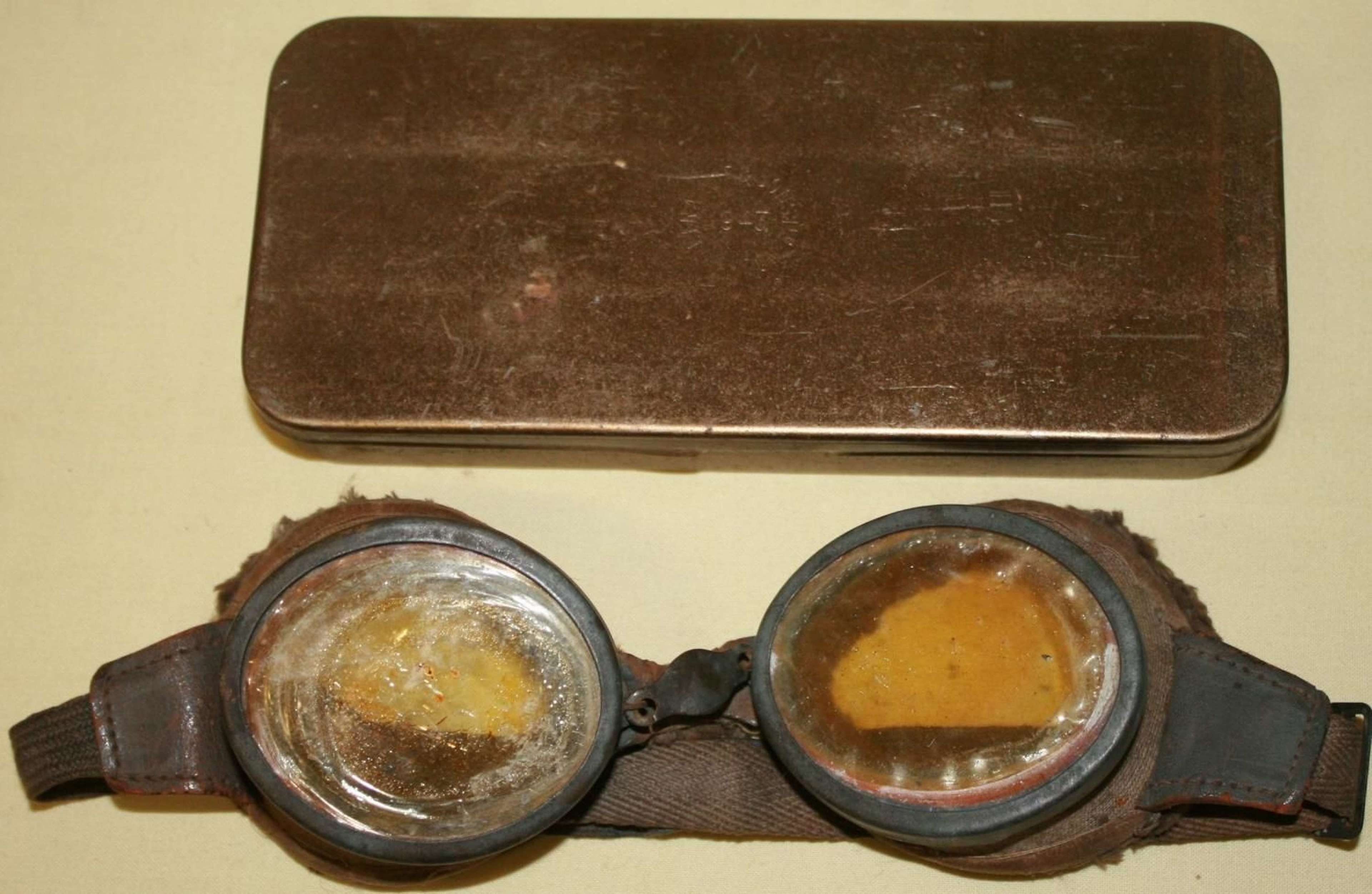 A USED PAIR OF THE BRITISH ORANGE DUST GOGGLES