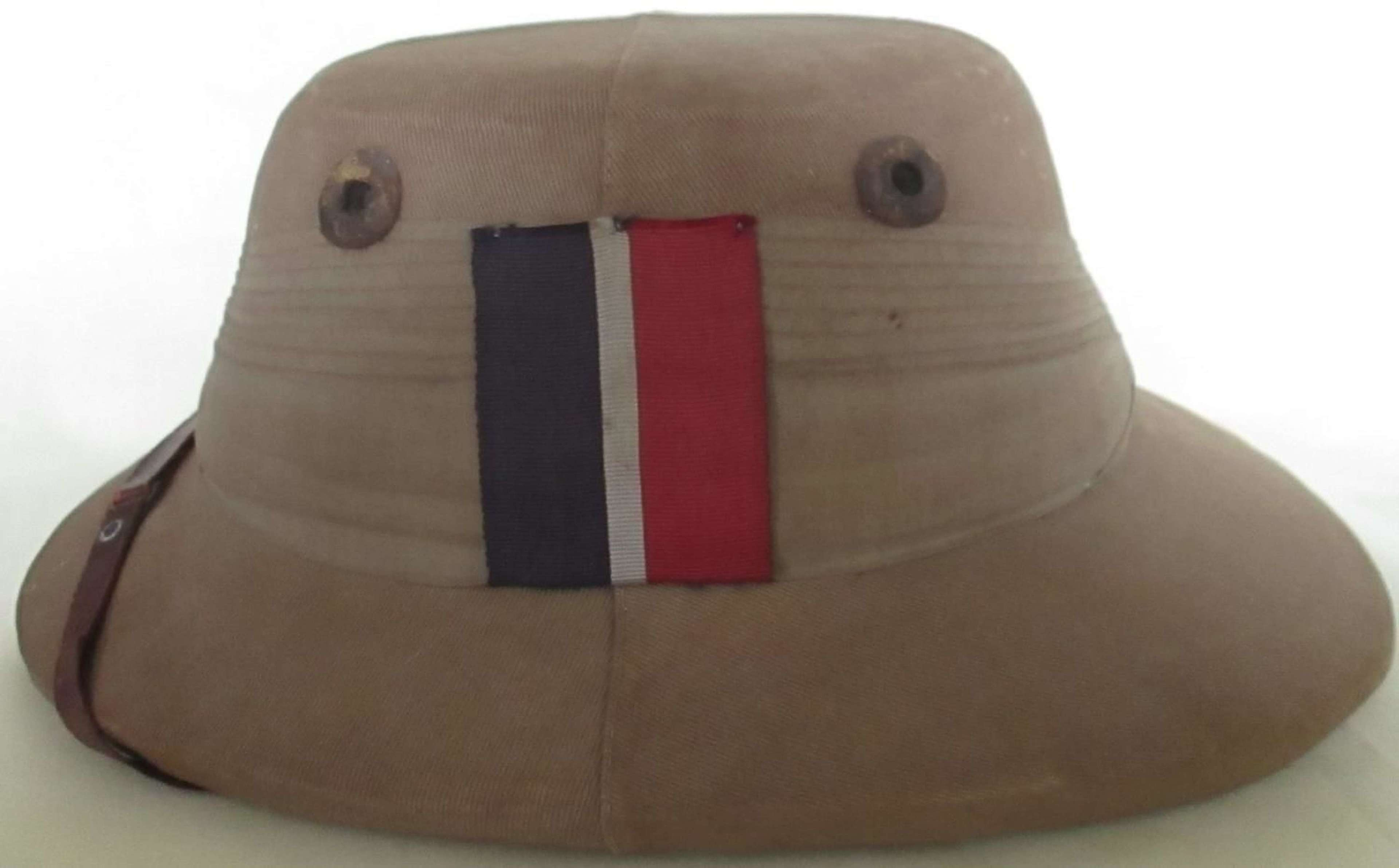 A VERY GOOD EARLY WWII RAF SOLAR HELMET