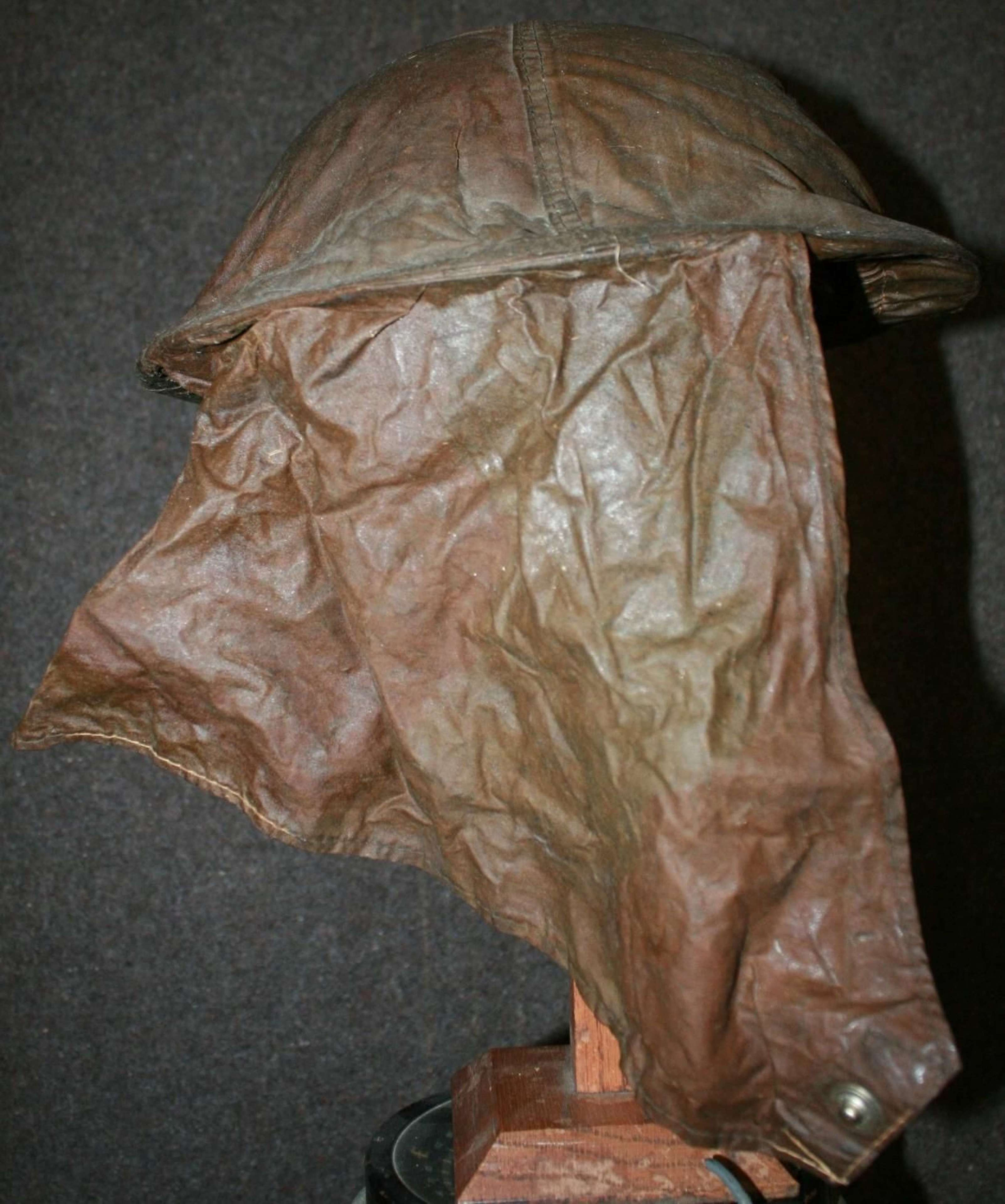 A WWII BRITISH TOMMY HELMET AND GAS HOOD