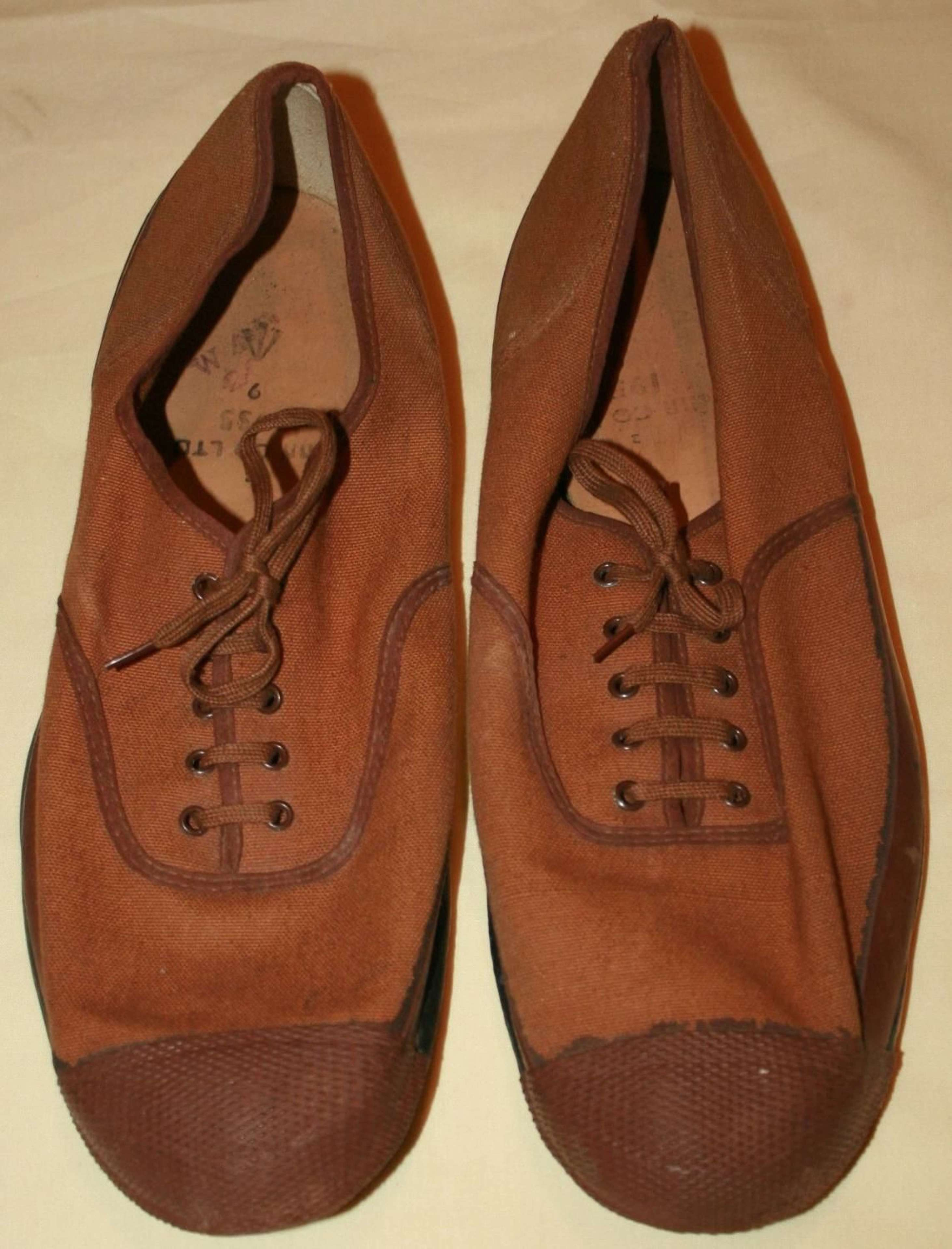 A GOOD USED PAIR OF THE BRITISH ARMY ISSUE PLIMSOLLS