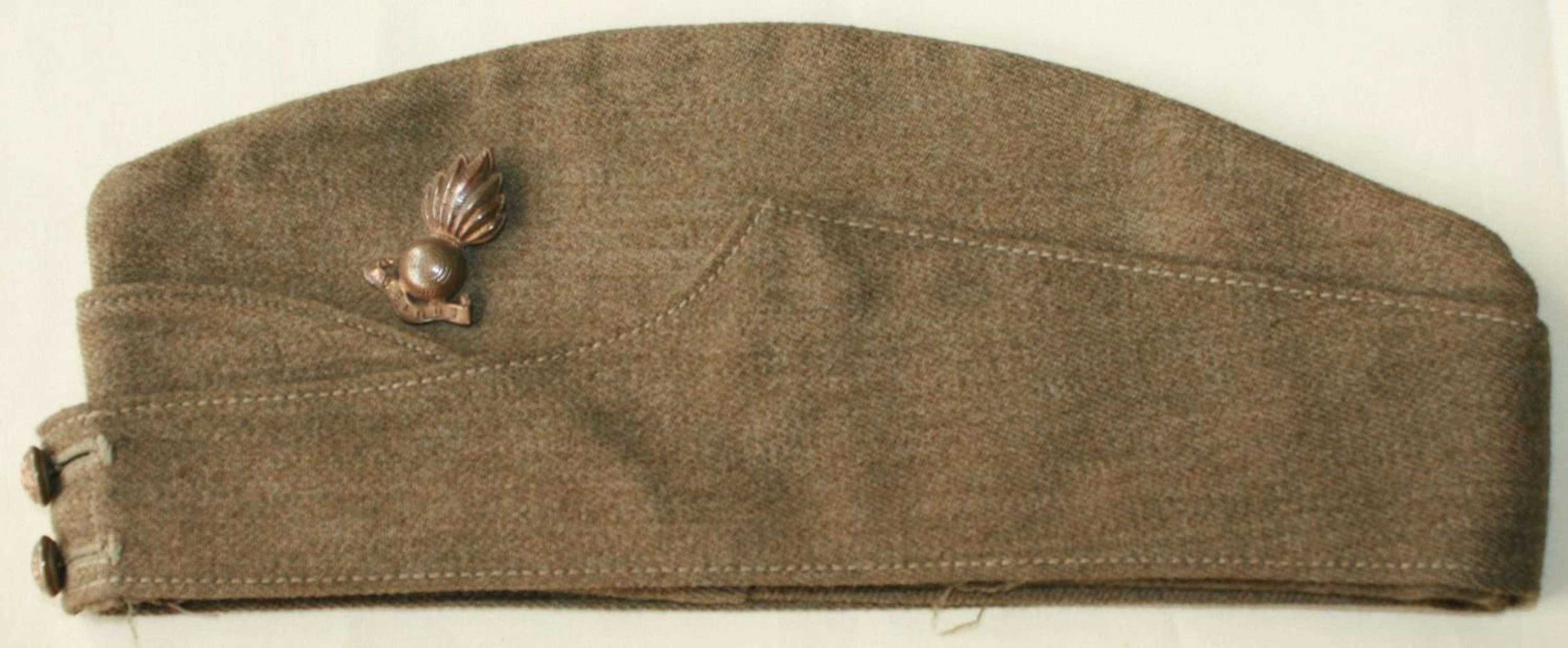 A WWII OR'S SIDE CAP ROYAL ARTILLERY BADGE & NUMBER
