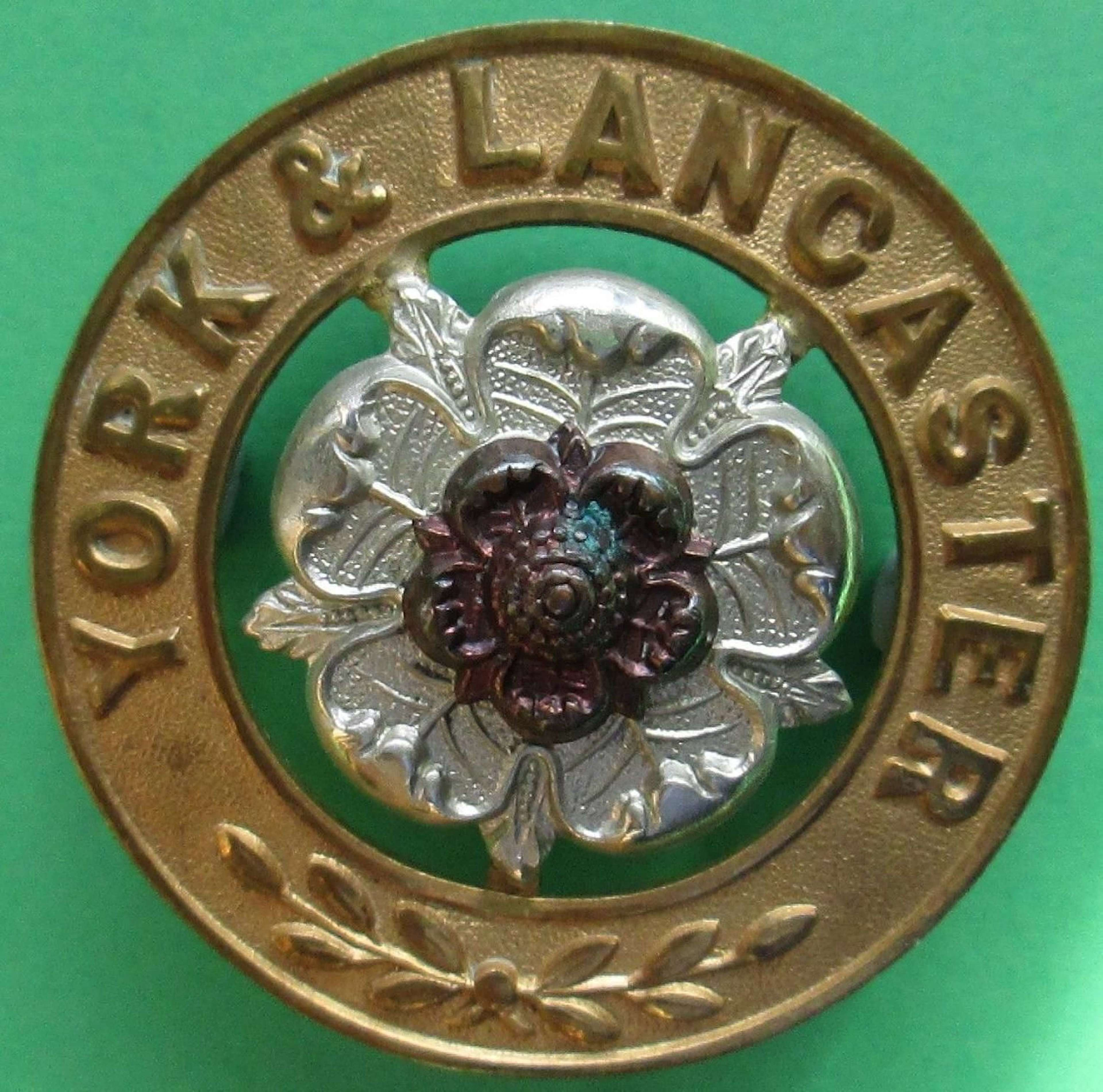 A YORK AND LANCASTER HELMET PLATE CENTRE