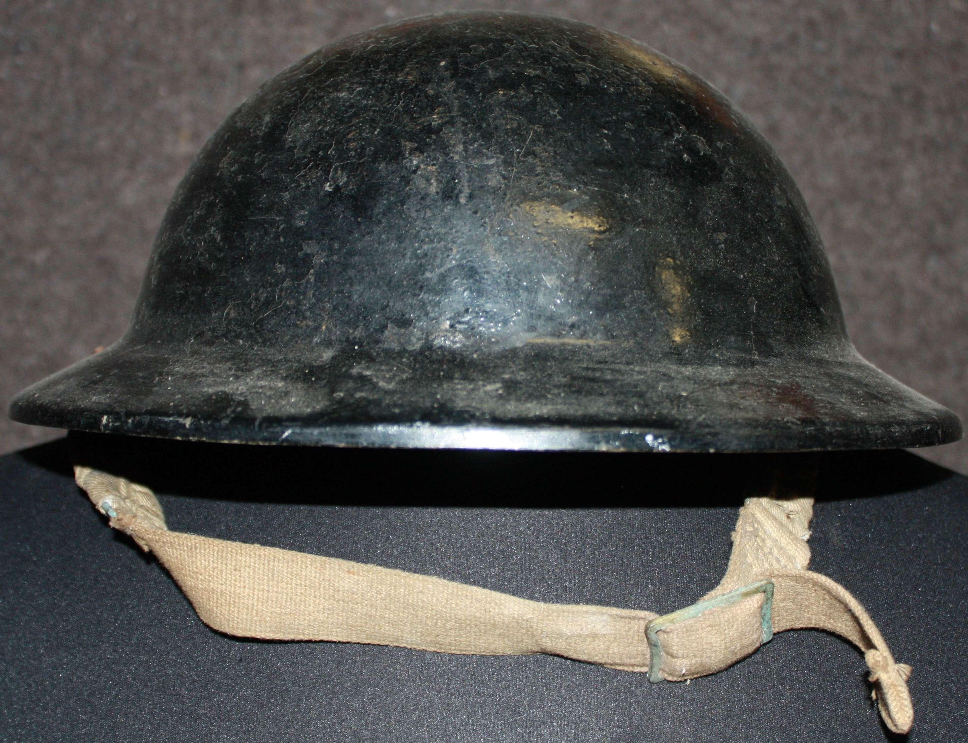 A WWII PLASTIC / FIBER BLACK WARDENS HELMET
