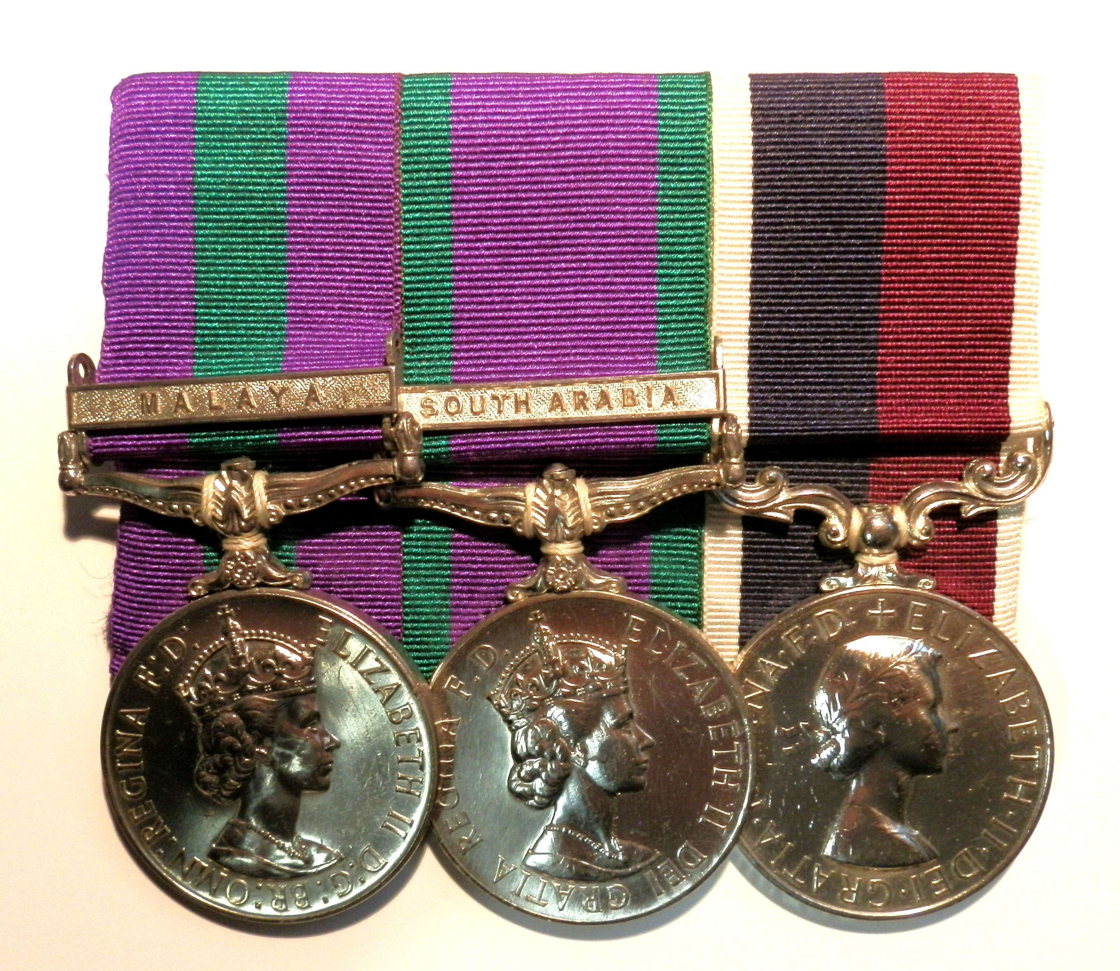 GROUP OF THREE. Sergeant N. Glaister. Royal Air Force.