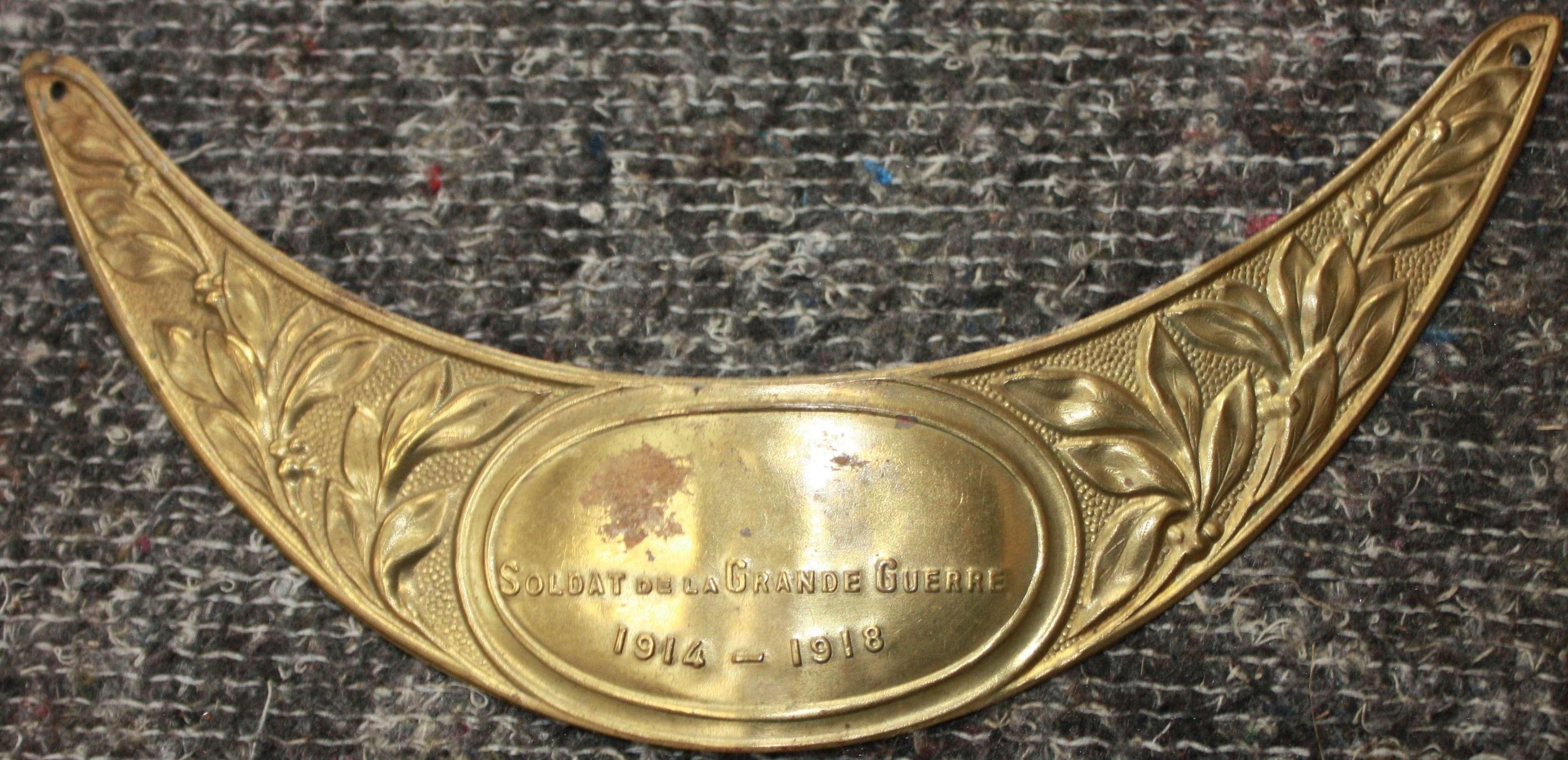 A WWI FRENCH HELMET VISOR MEMORIAL PLATE