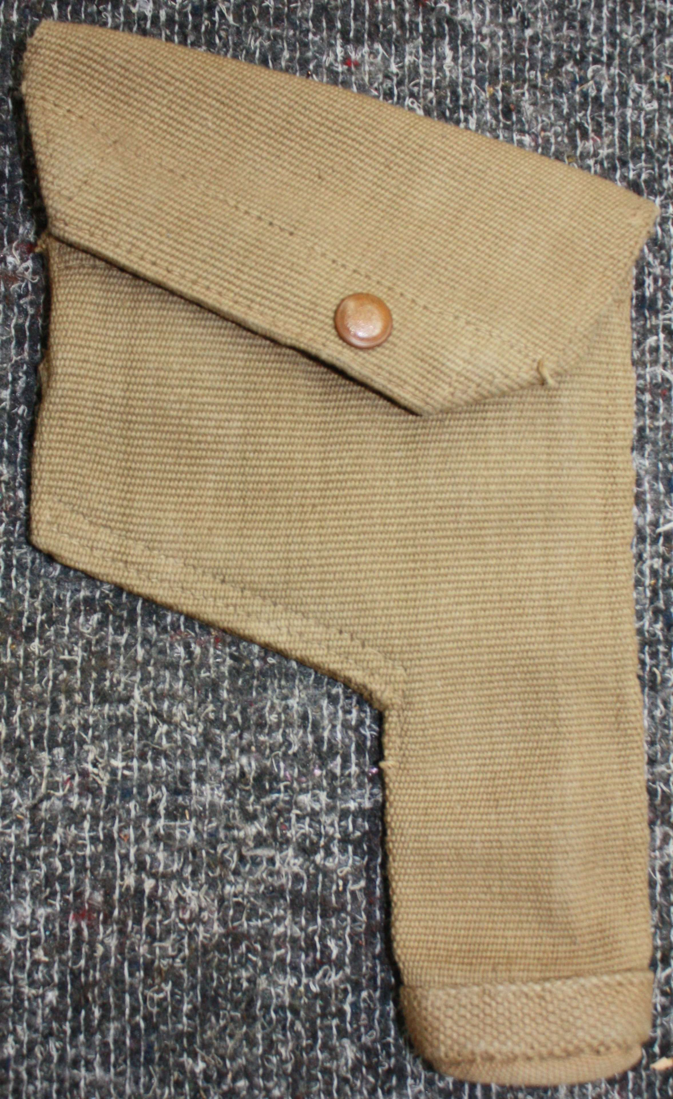 A MINT 1942 DATED 37 PATTERN WEBBING HOLSTER