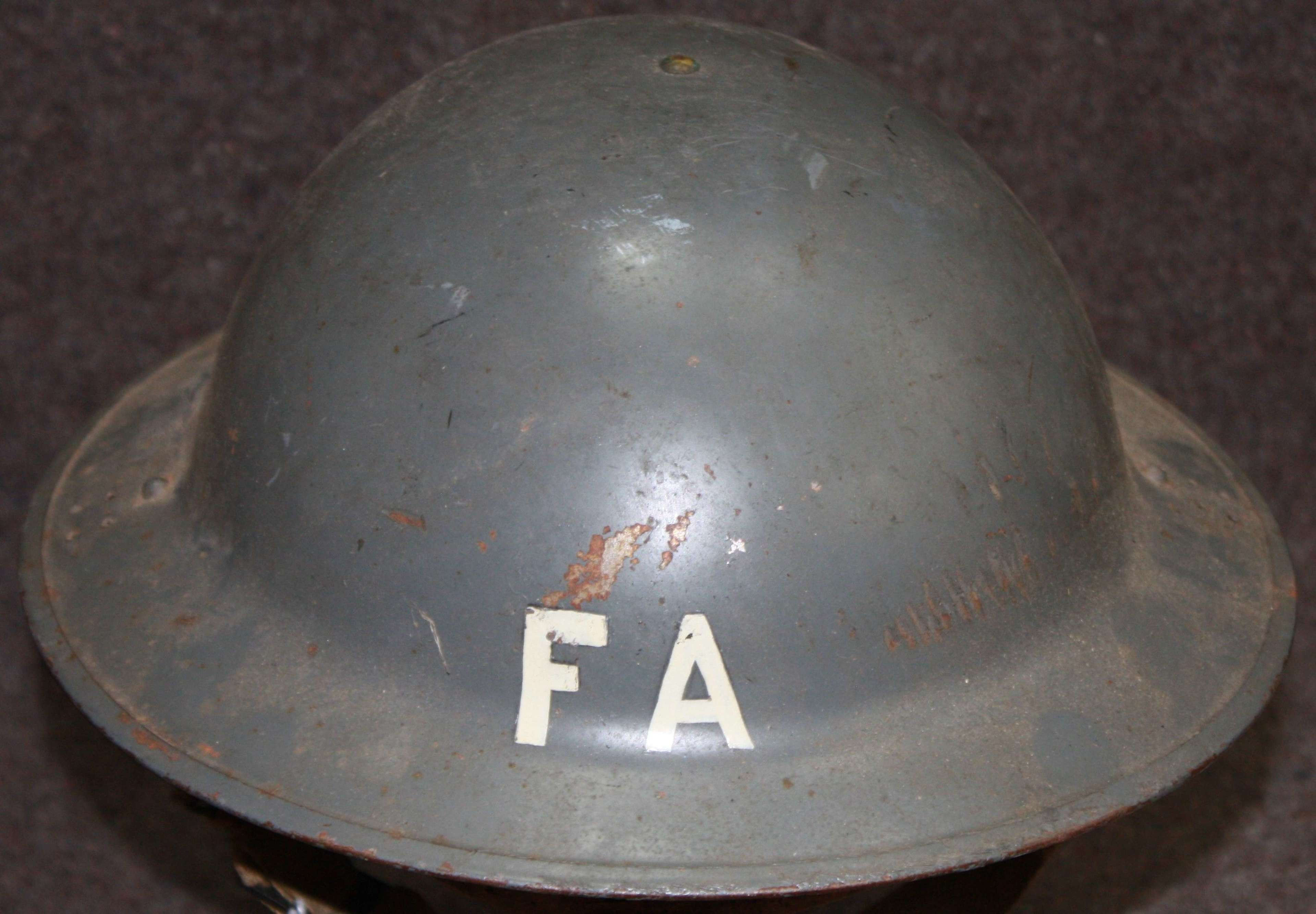 A WWII GREY CIVIL DEFENCE HELMET WITH FA ( FIRST AIDER )