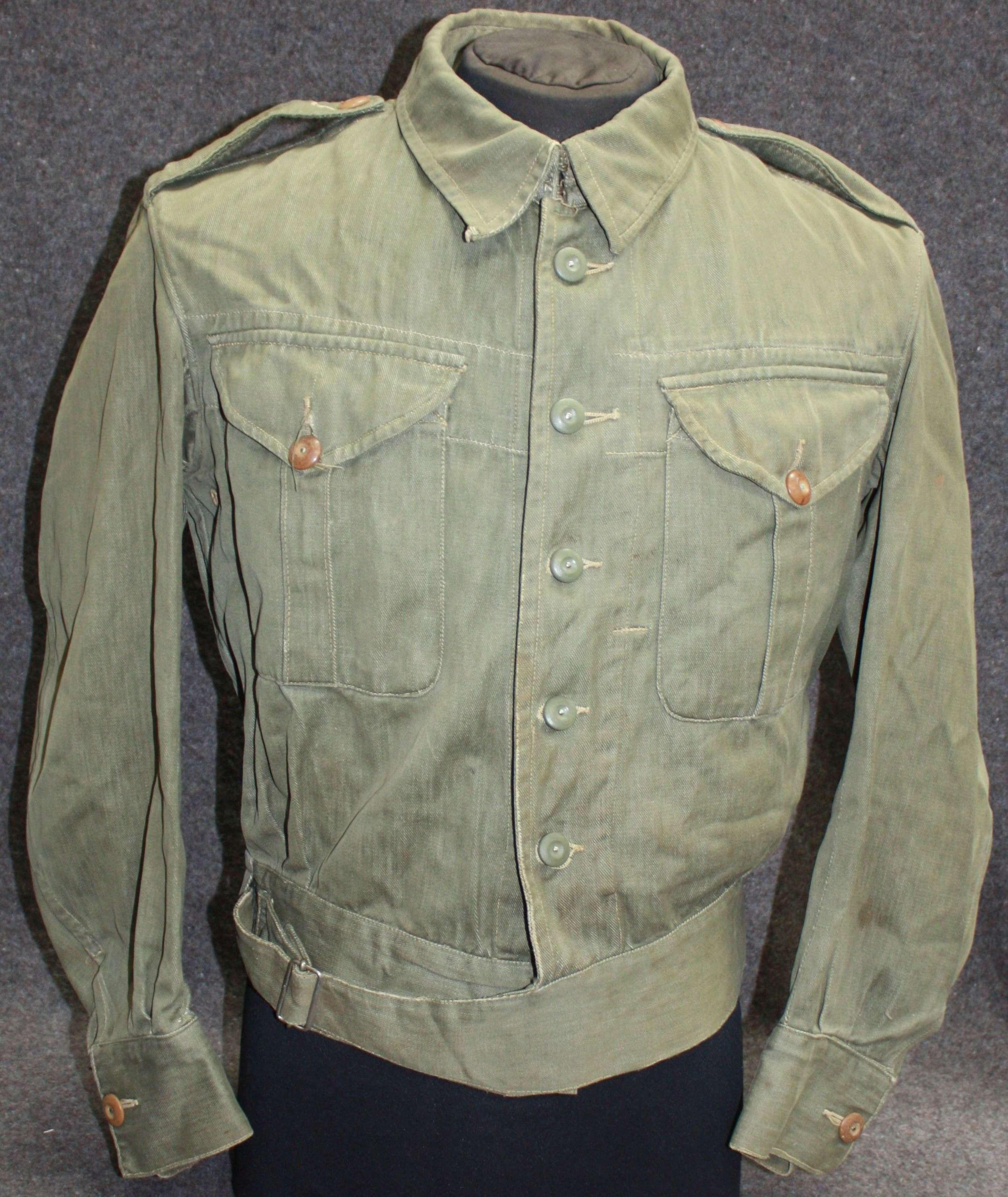A GOOD USED EARLY WAR PATTERN DENIM BATTLE DRESS BLOUSE