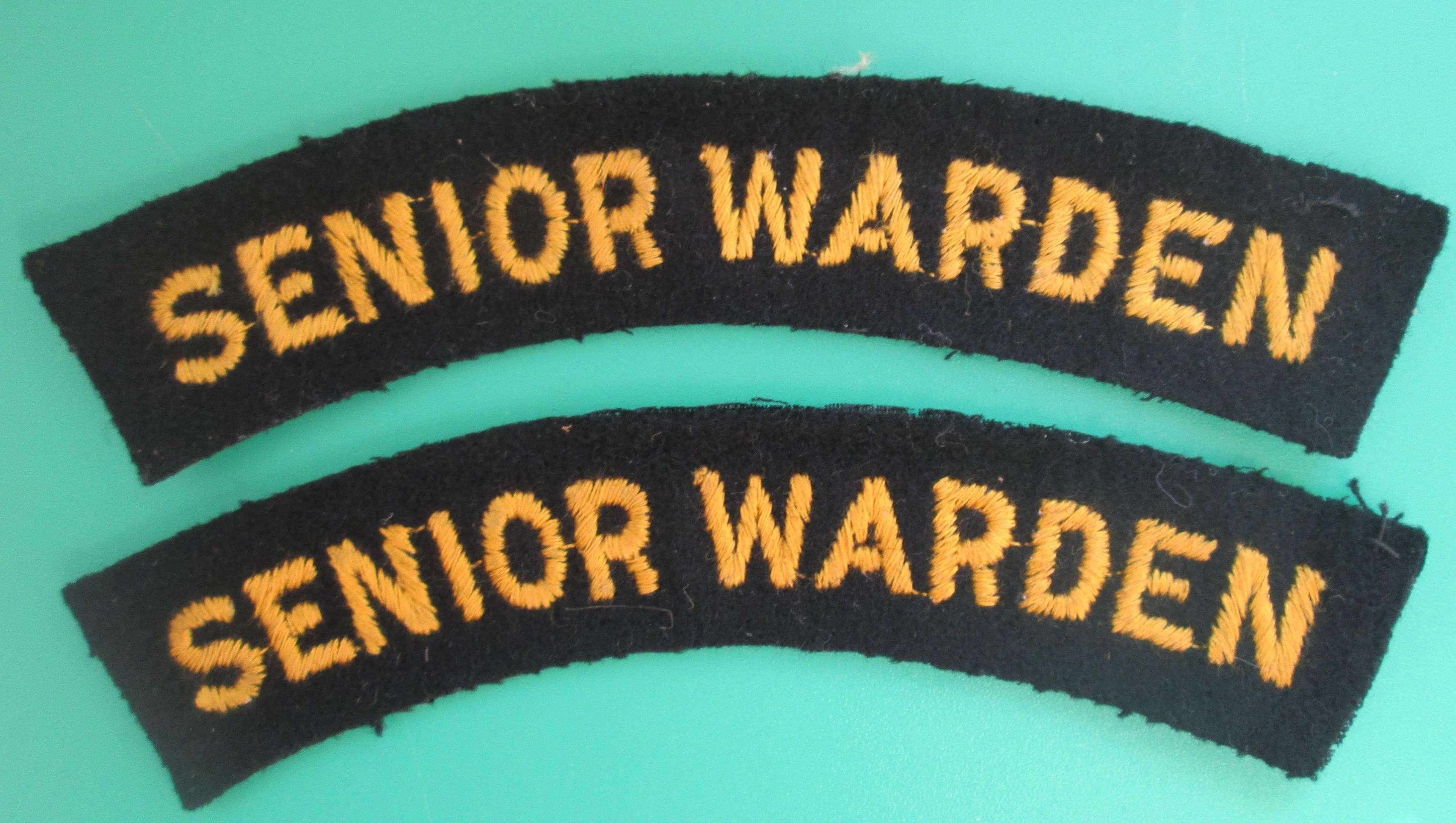 A PAIR OF SENIOR WARDENS SHOULDER TITLES