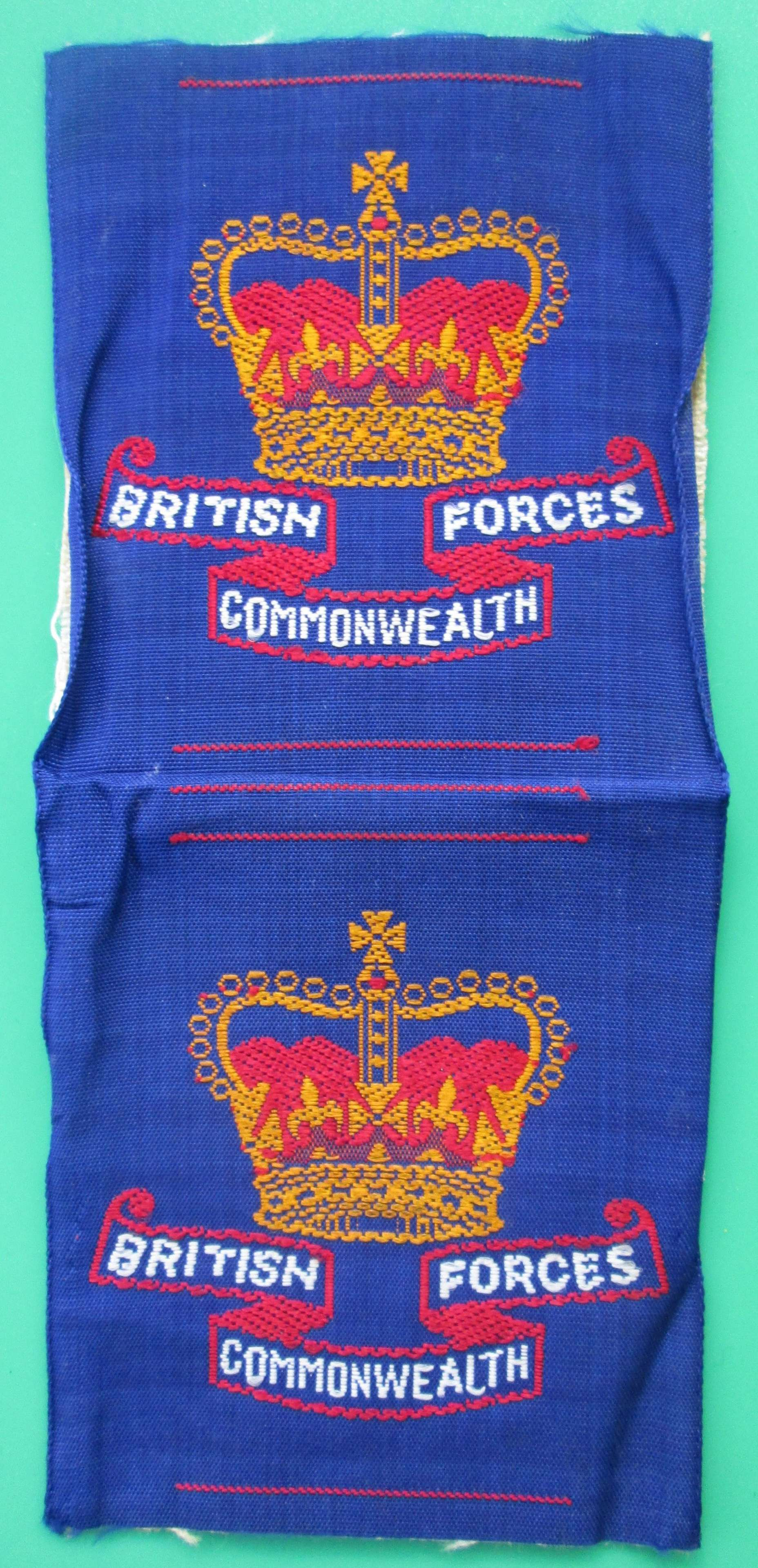 AN UNCUT PAIR OF POST WAR BRITISH FORCES FORMATION SIGNS