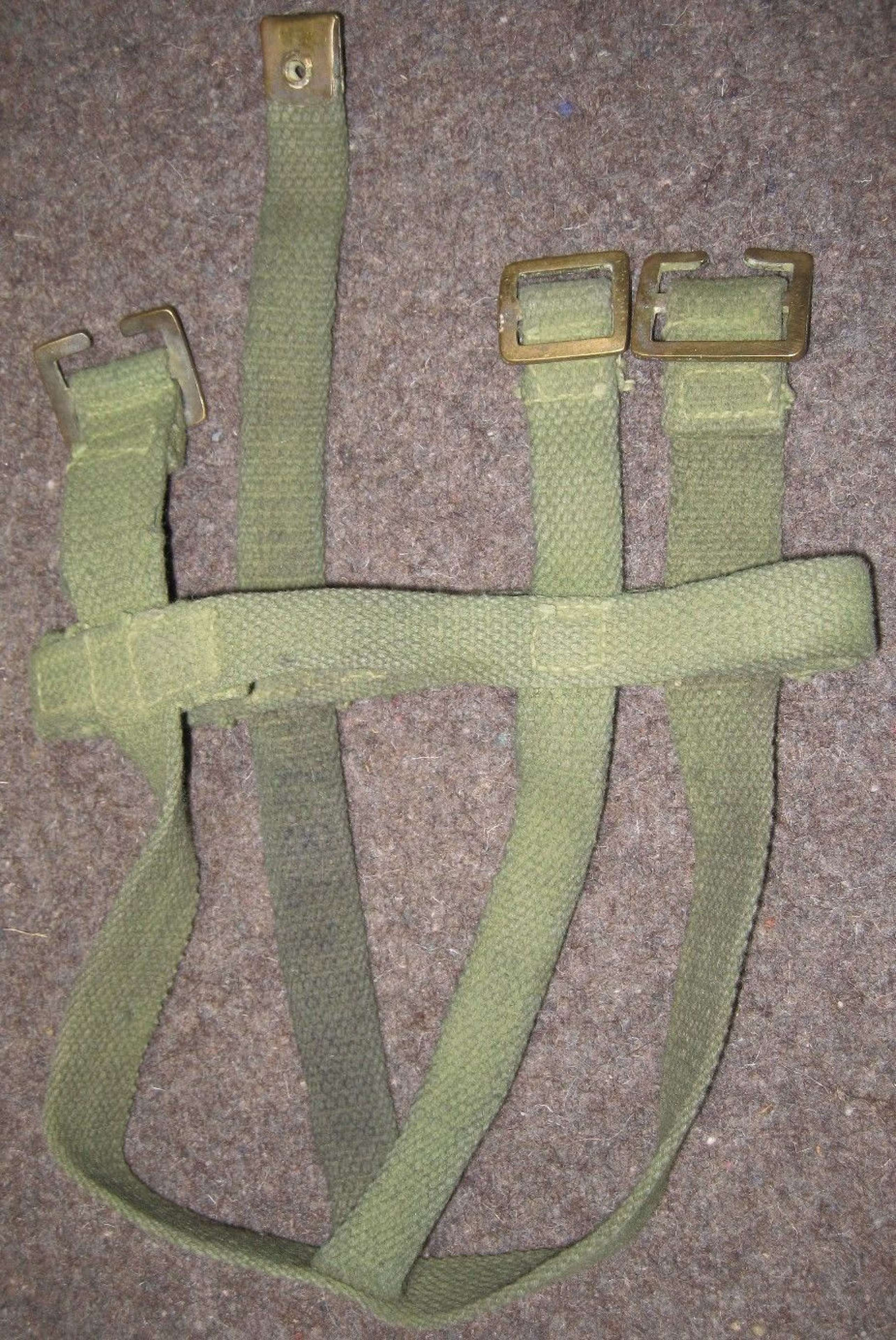 A WWII INDIAN WATER BOTTLE CRADLE IN JUNGLE GREEN USED EXAMPLE