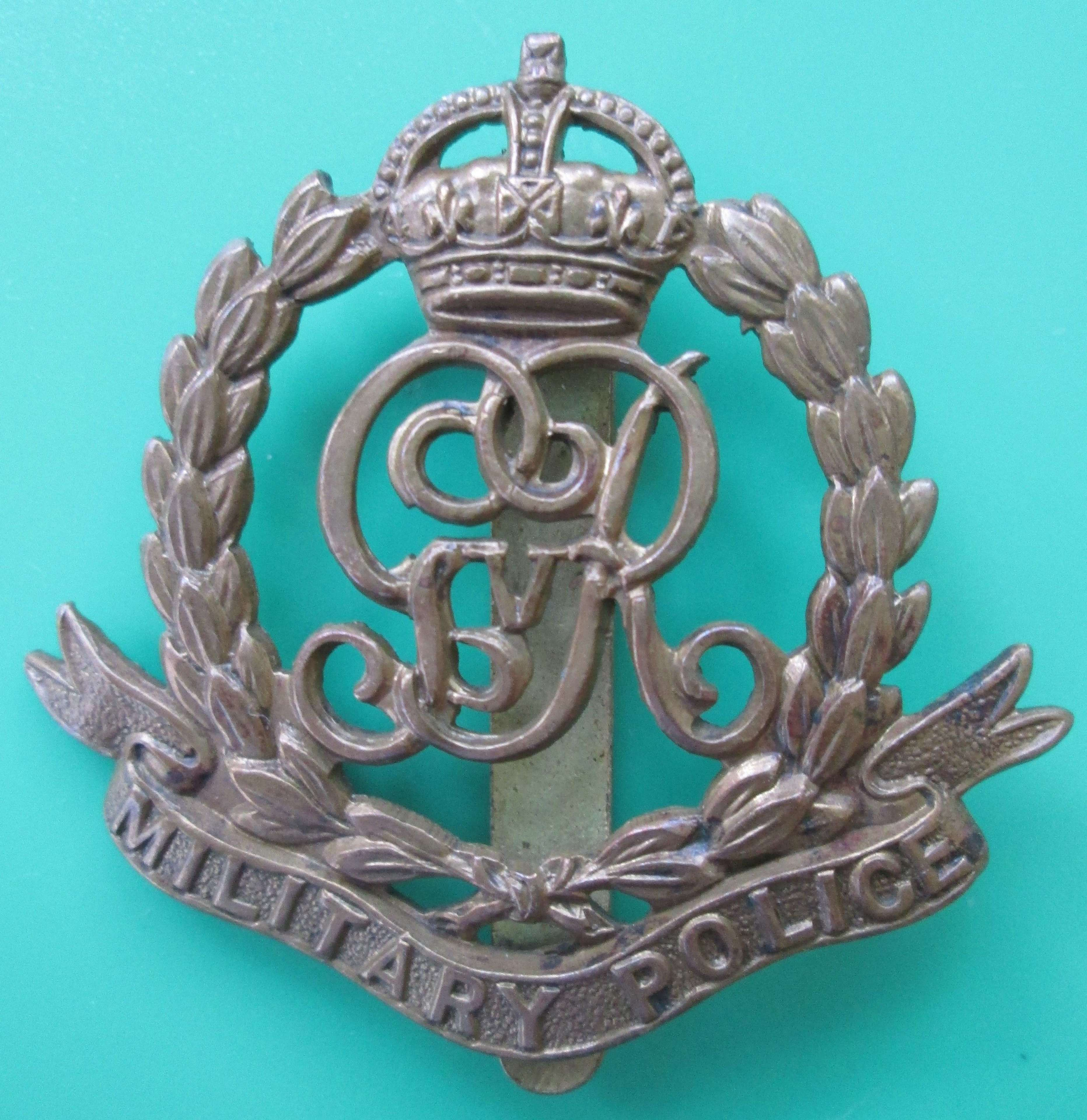 A MILITARY POLICE CAP BADGE