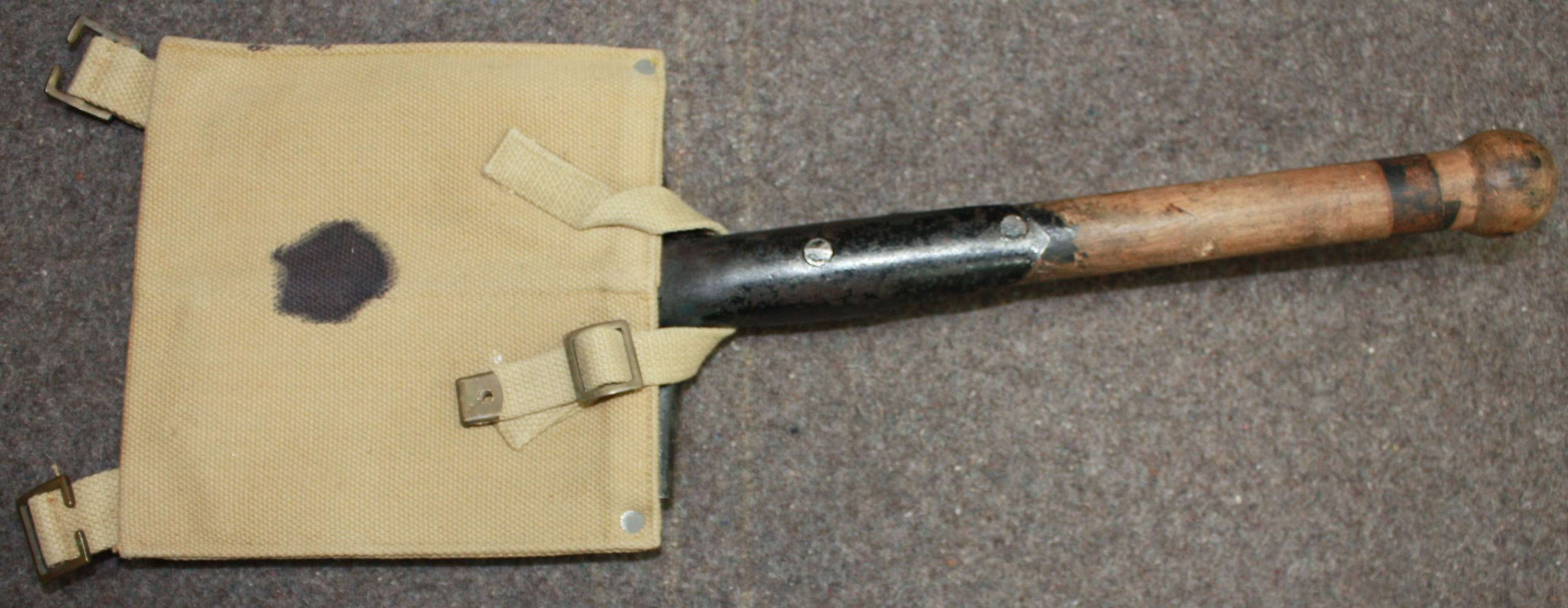 A GOOD BRITISH 37 PATTERN ENTRENCHING TOOL SPADE AND HOLDER