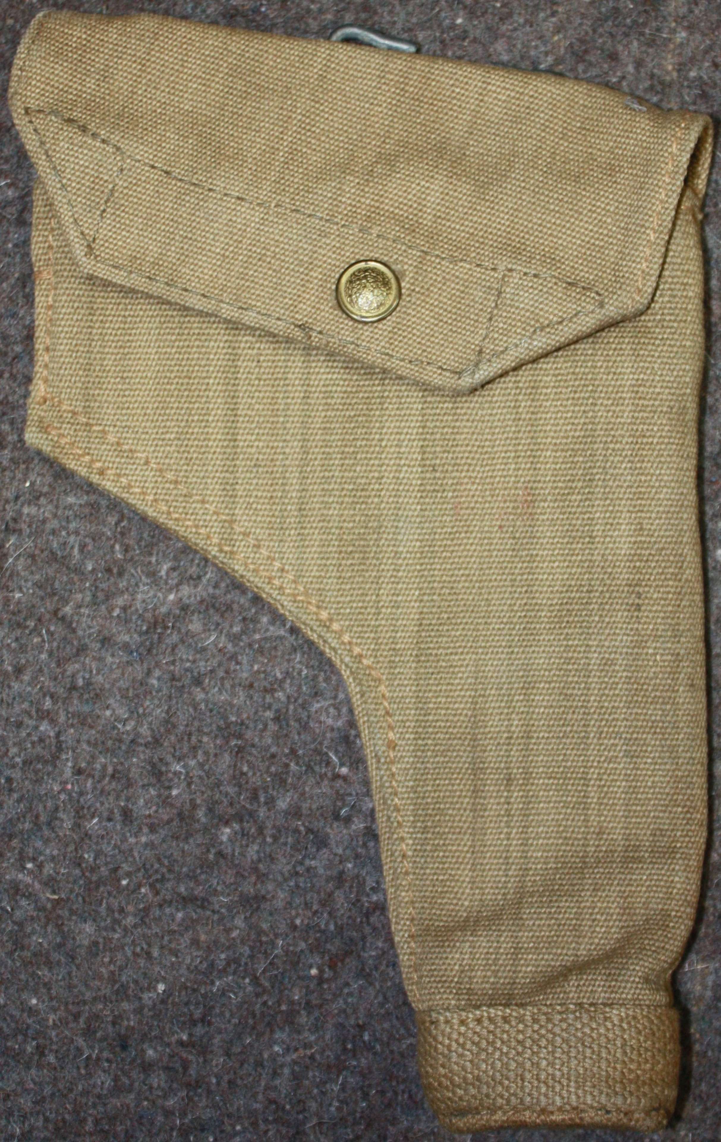 A GOOD MINT WWII 1943 DATED 37 PATTERN WEBBING HOLSTER