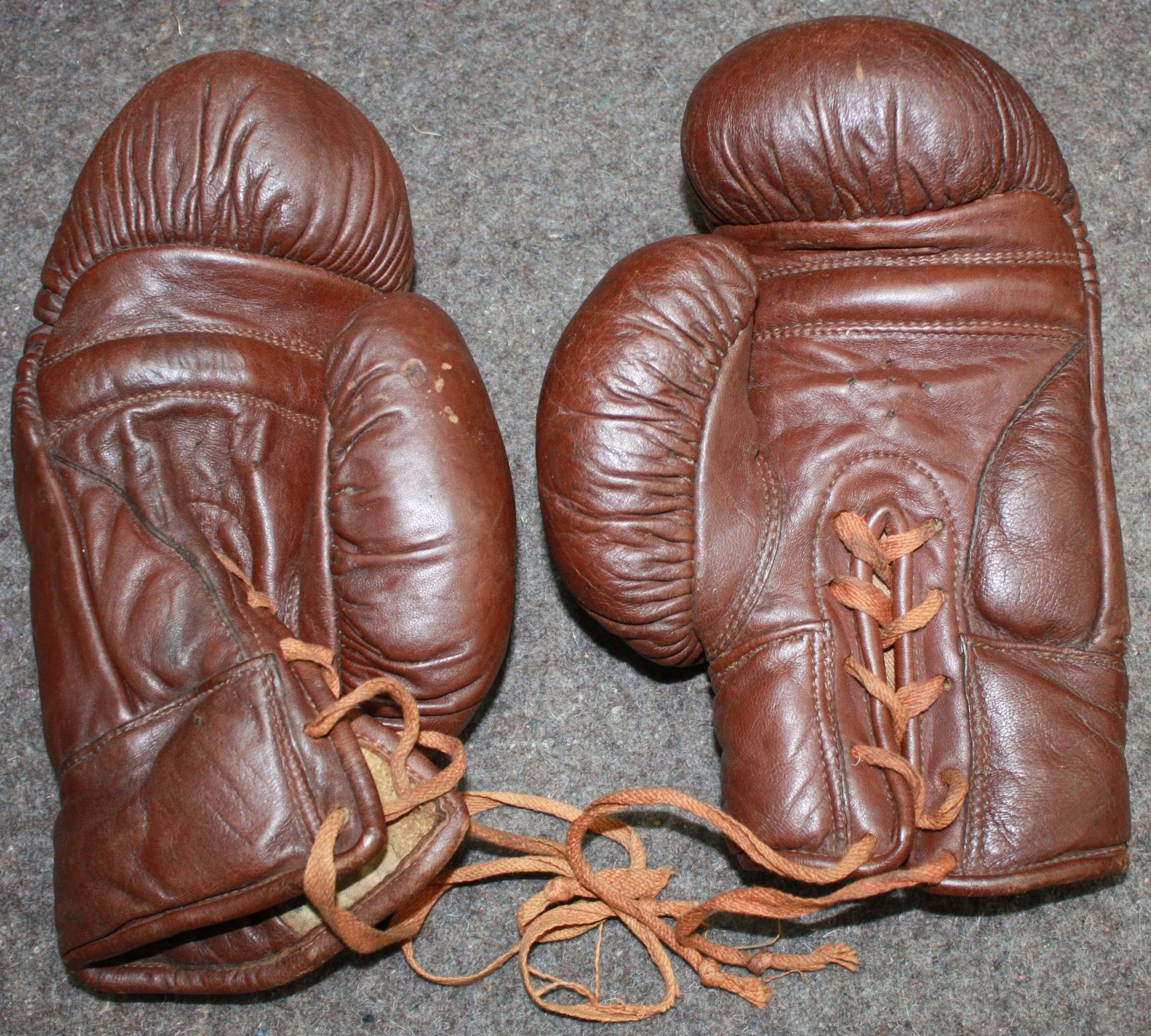 A RARE PAIR OF WWII 1942 DATED BRITISH FORCES BOXING GLOVES