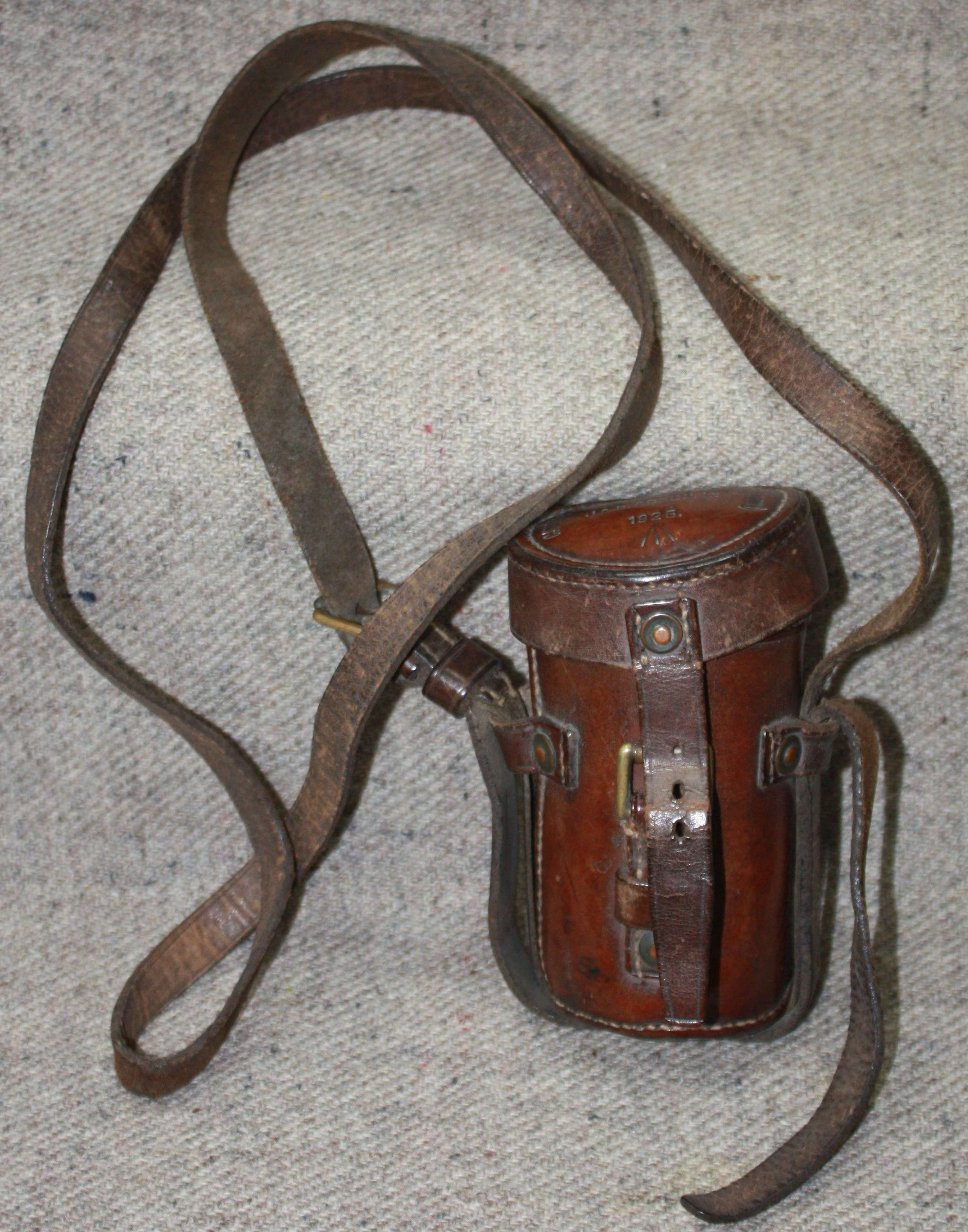 A RARE SMALL SIZE LEATHER MONOCULAR CASE 1925 DATED