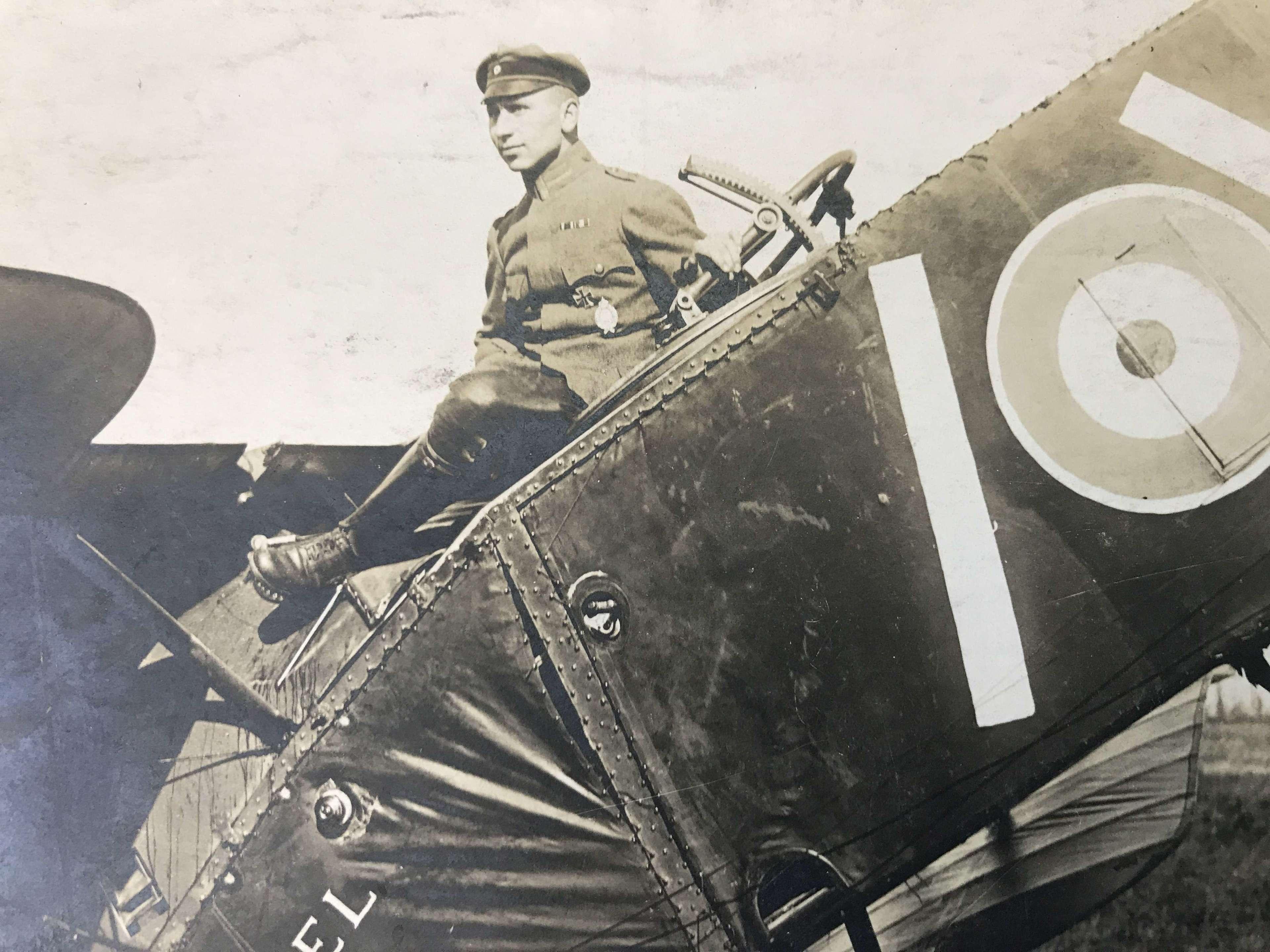 A Postcard Of a German pilot sitting on a Bristol fighter