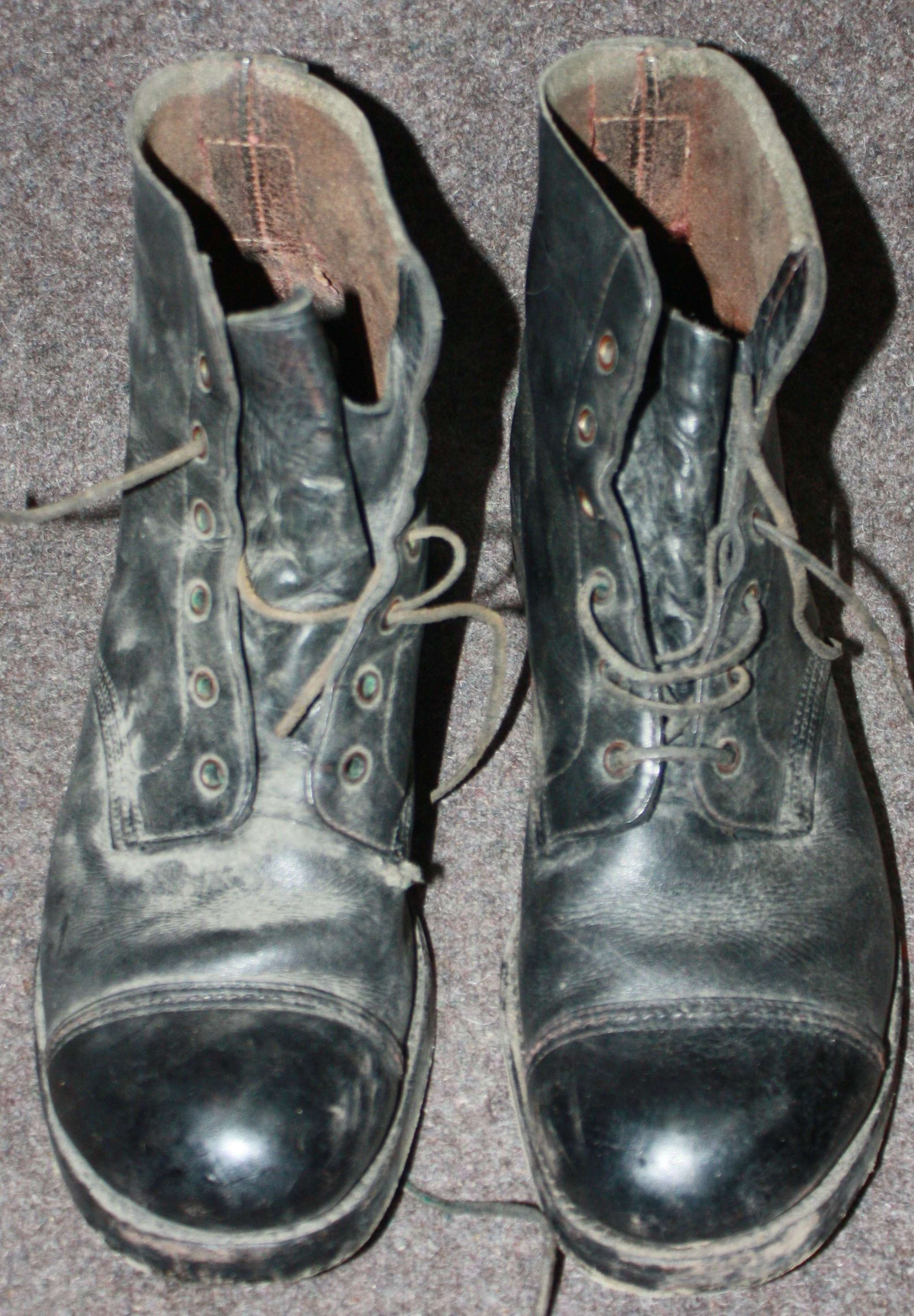 A BLACKENED PAIR OF THE BRITISH LEATHER JUNGLE BOOTS 1944 DATED SIZE 9