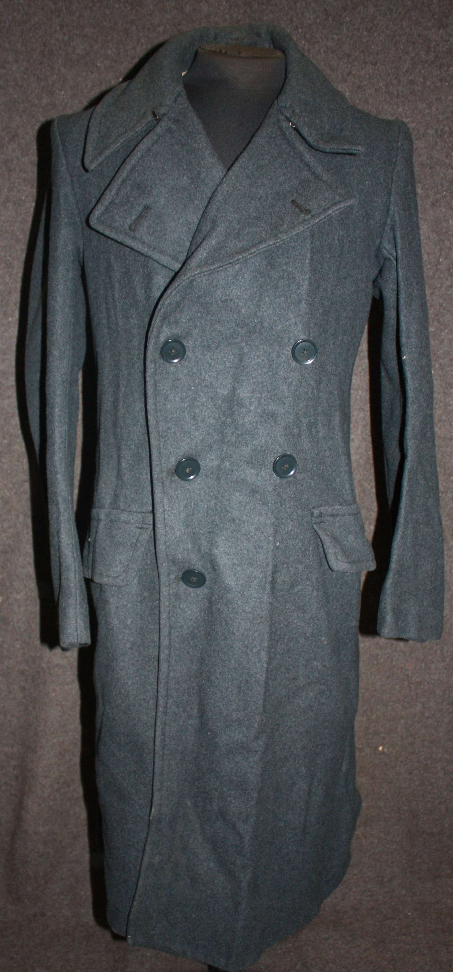 A 1945 DATED RAF GREY COAT LARGE SIZE