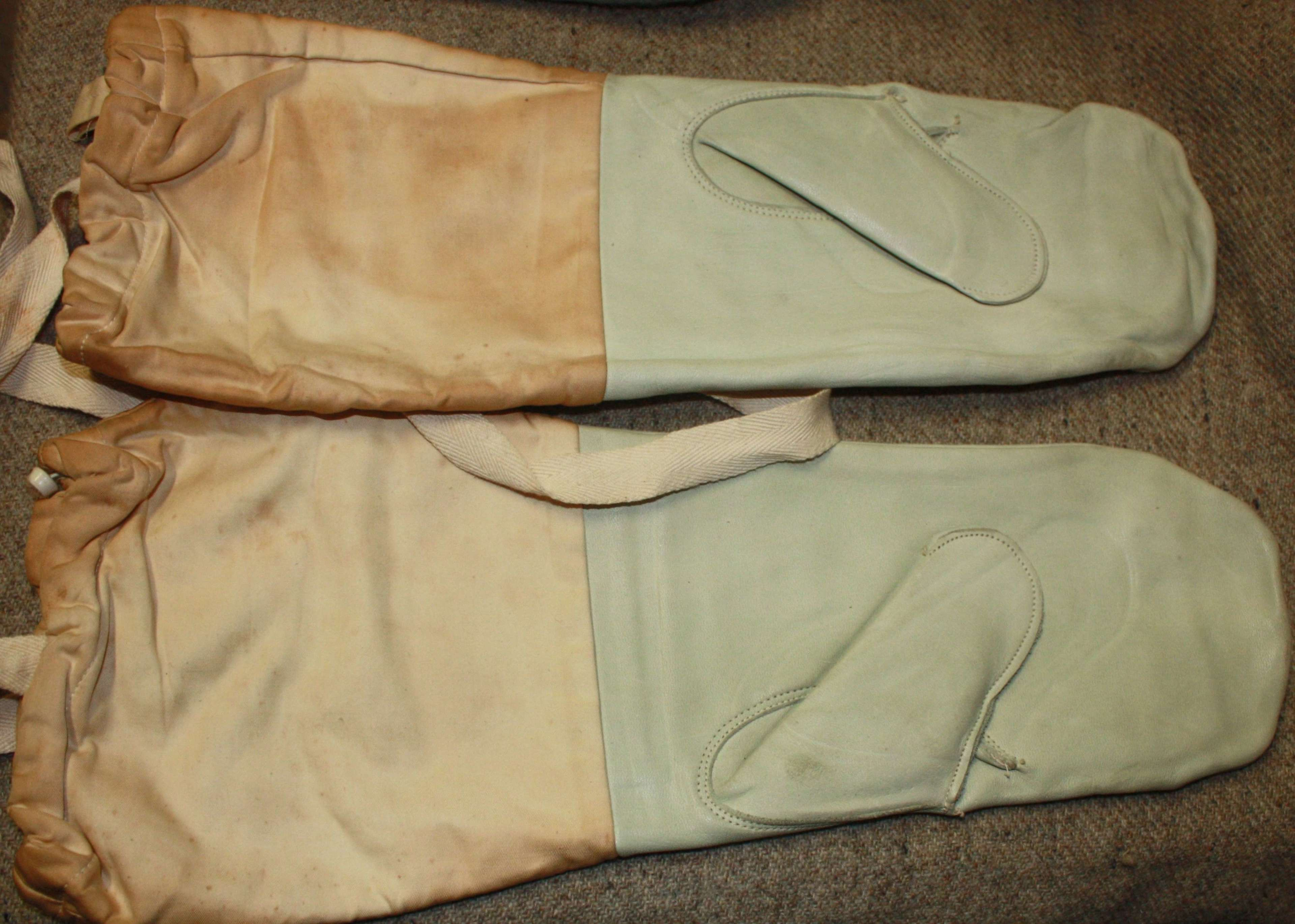 A PAIR OF 1941 SNOW MITTENS AND THE GREY WOOL MITTENS