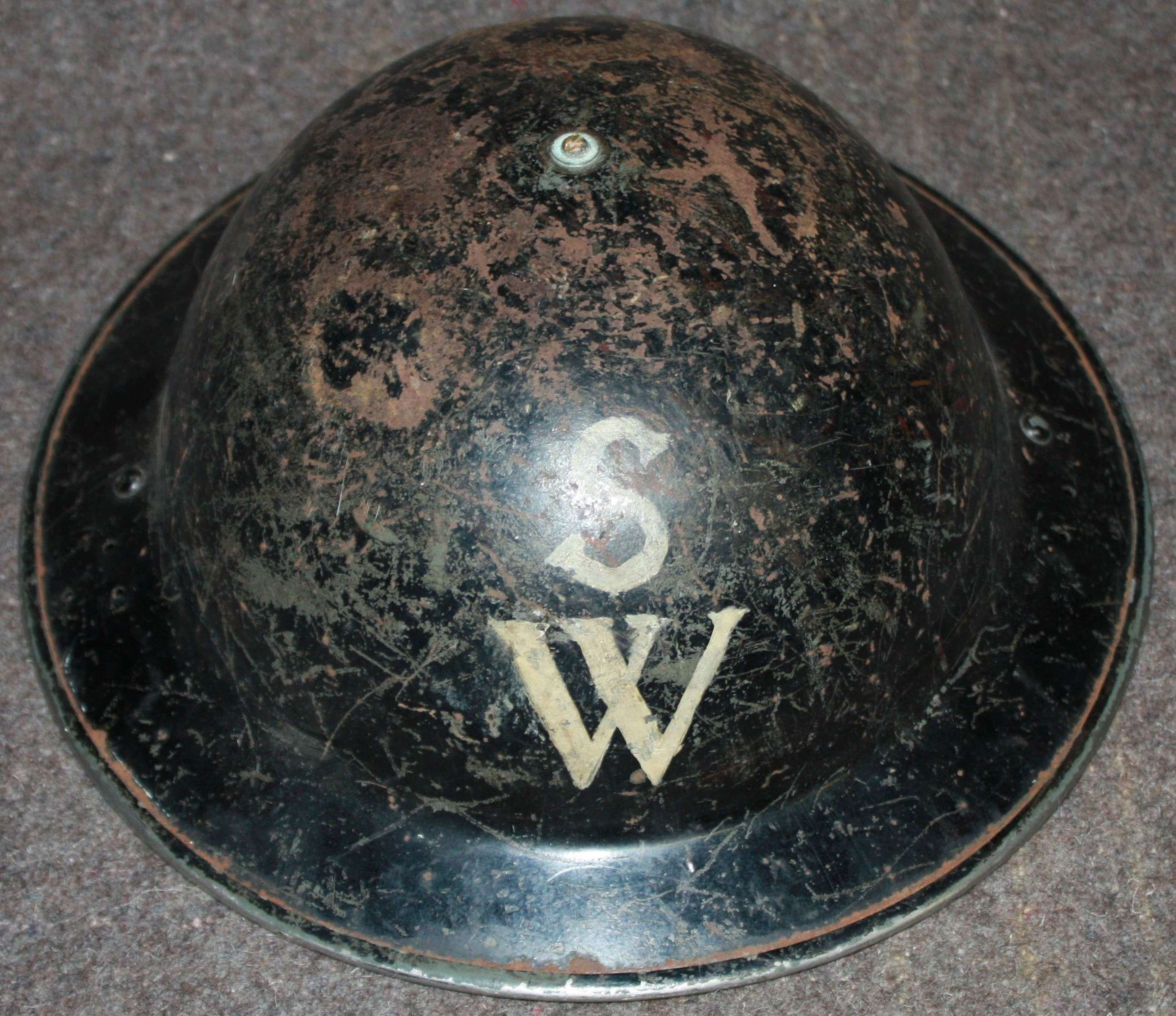 A GOOD USED EXAMPLE OF A SHELTER WARDEN / SCHOOL WARDENS HELMET