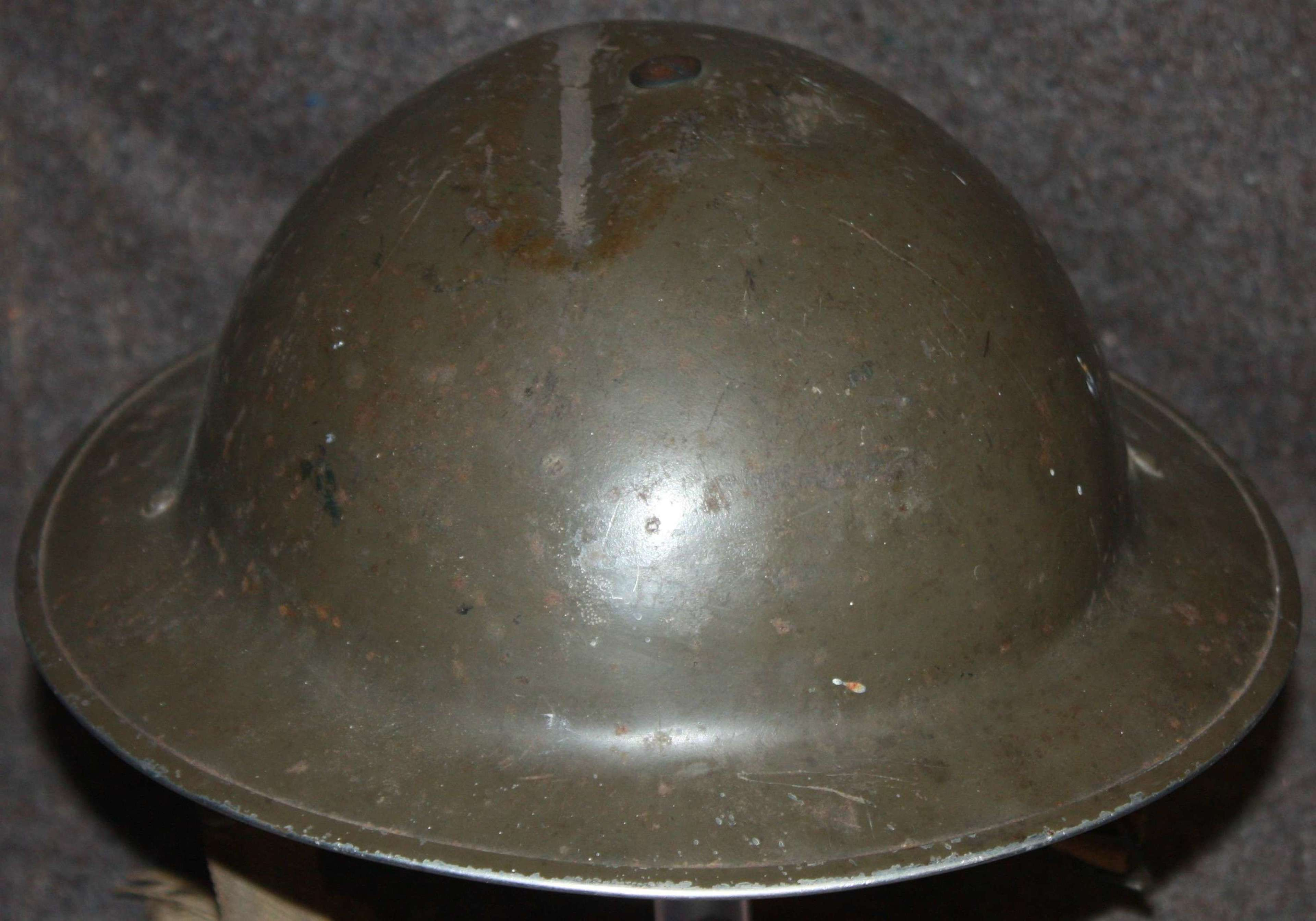 A DAMAGED WWII 1939 DATED TOMMY HELMET