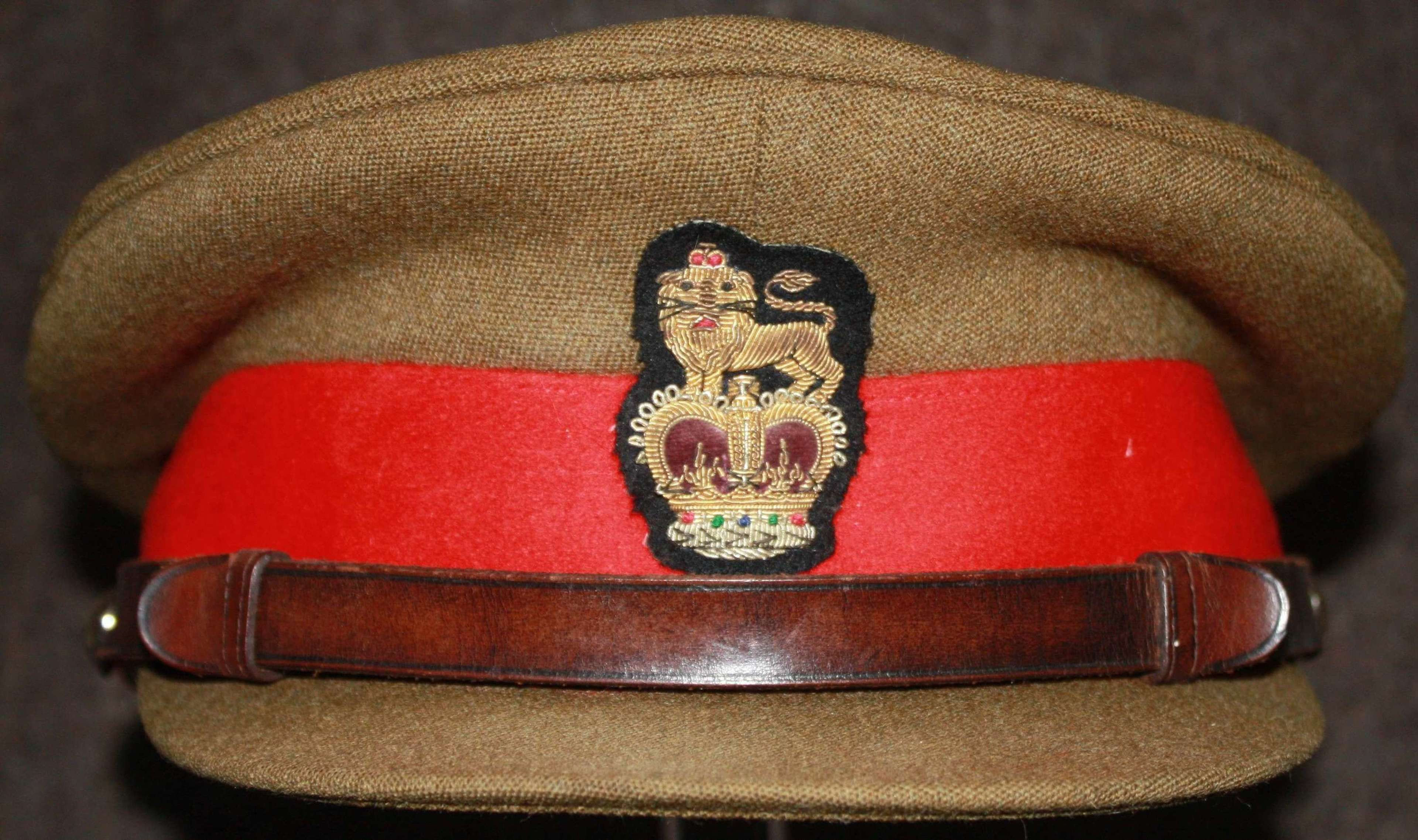 A FAIRLY MODERN BRIGADIERS CAP AND BERET LARGE SIZE 7 1/2
