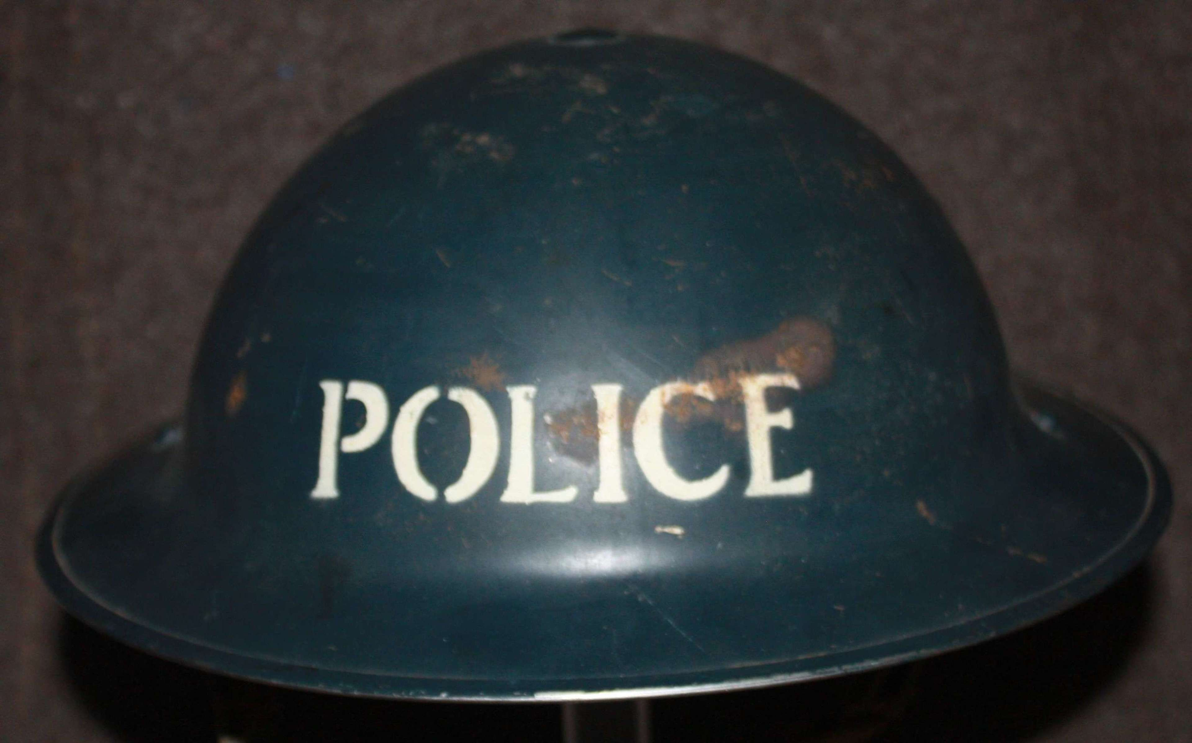 A GOOD WWII 1938 DATED POLICE HELMET