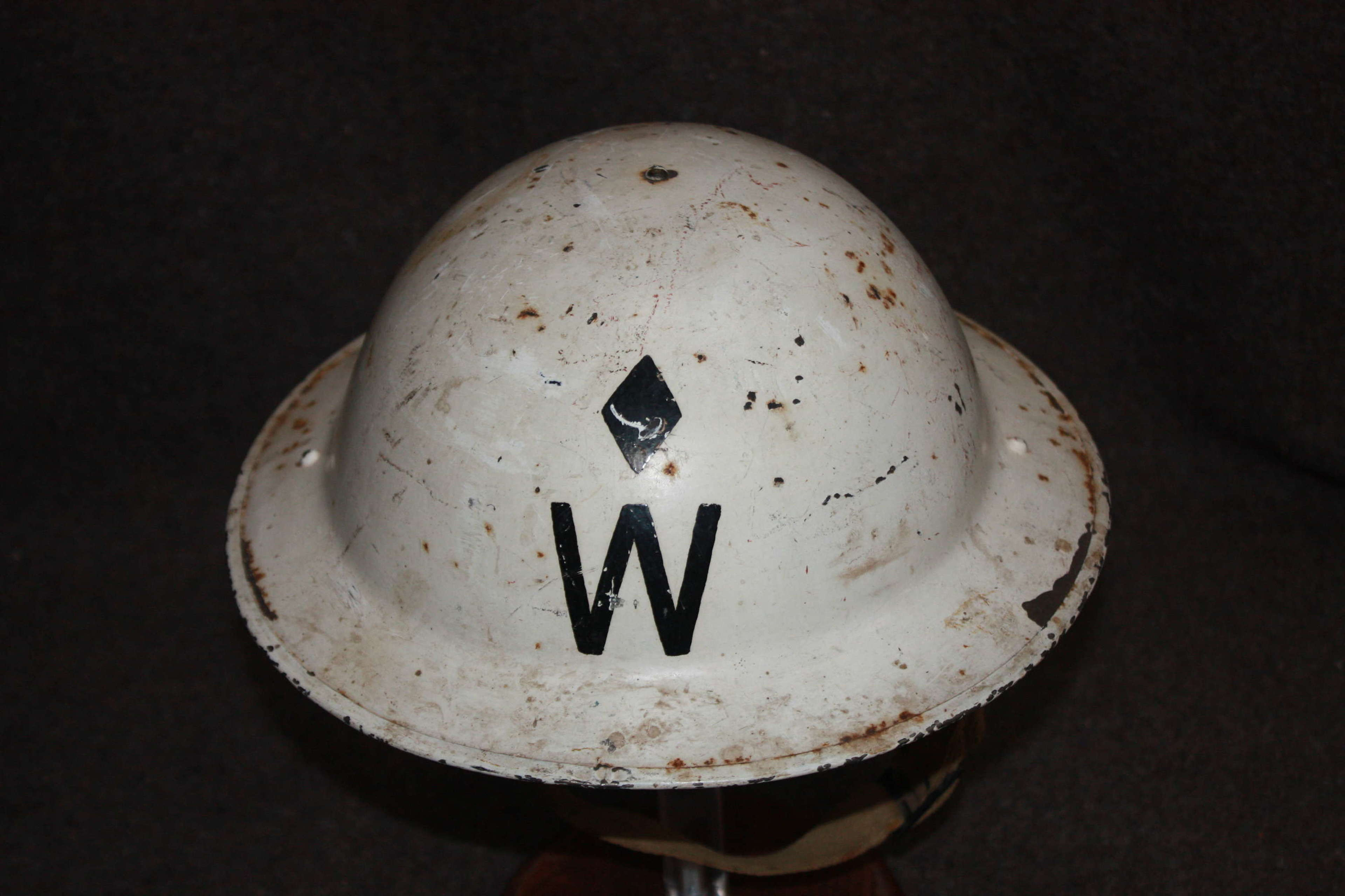 A GOOD WWII SENIOR WARDENS HELMET WITH A DIAMOND ABOVE THE W