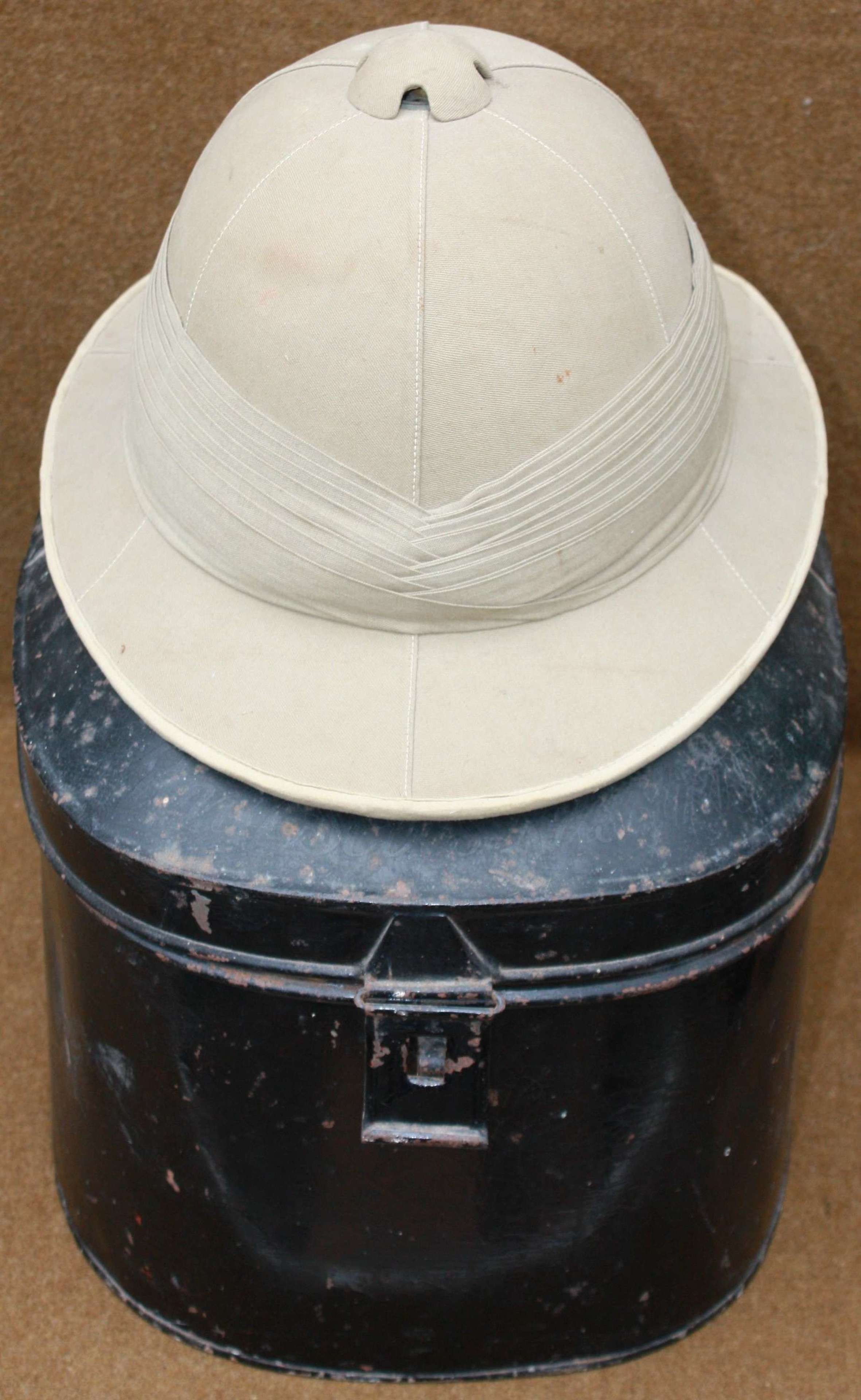 A VERY GOOD LATE 1930'S PERIOD EARLY WWII SOLAR HELMET AND TIN NAMED