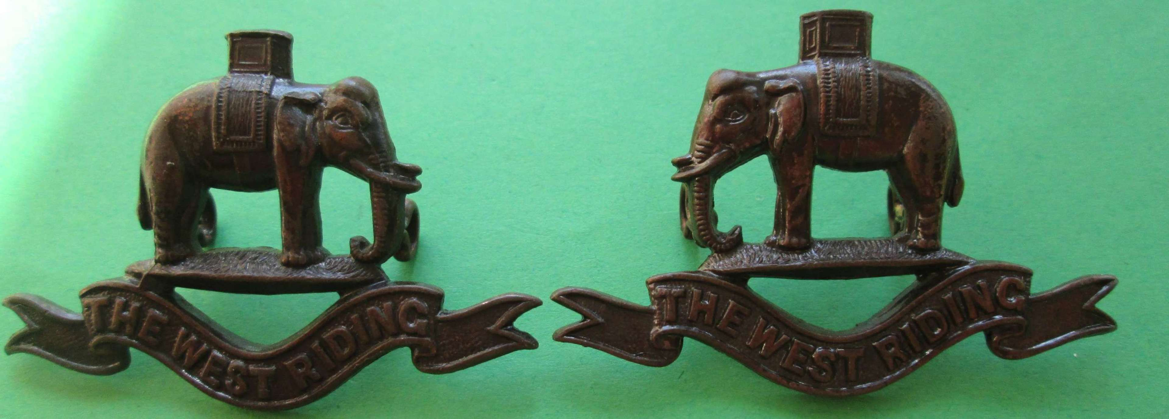 A PAIR OF WEST RIDING OFFICERS BRONZE COLLAR DOGS