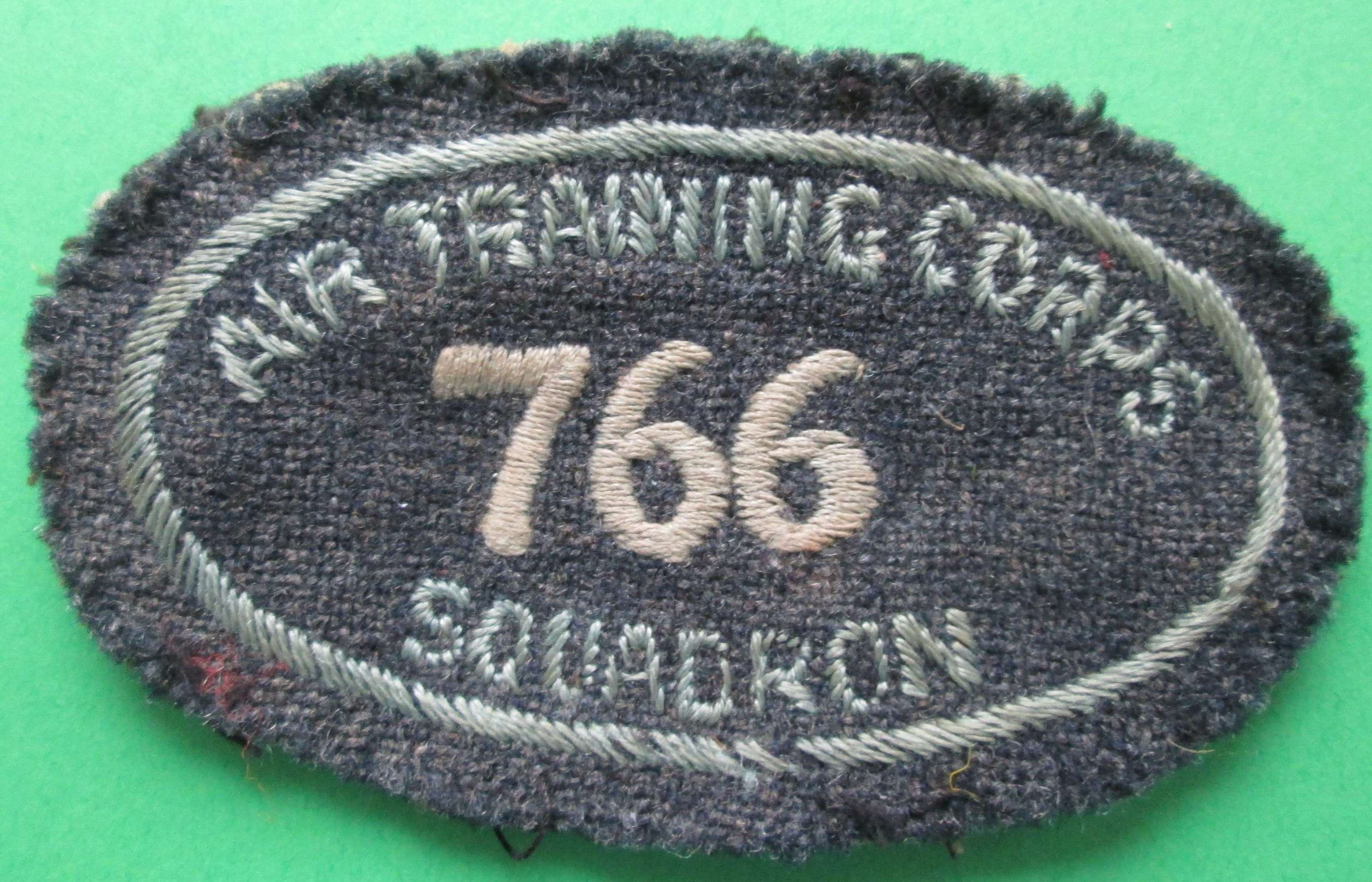 A GOOD LATE WWII EARLY POST WWII ATC 766 SQUADRON ARM BADGE