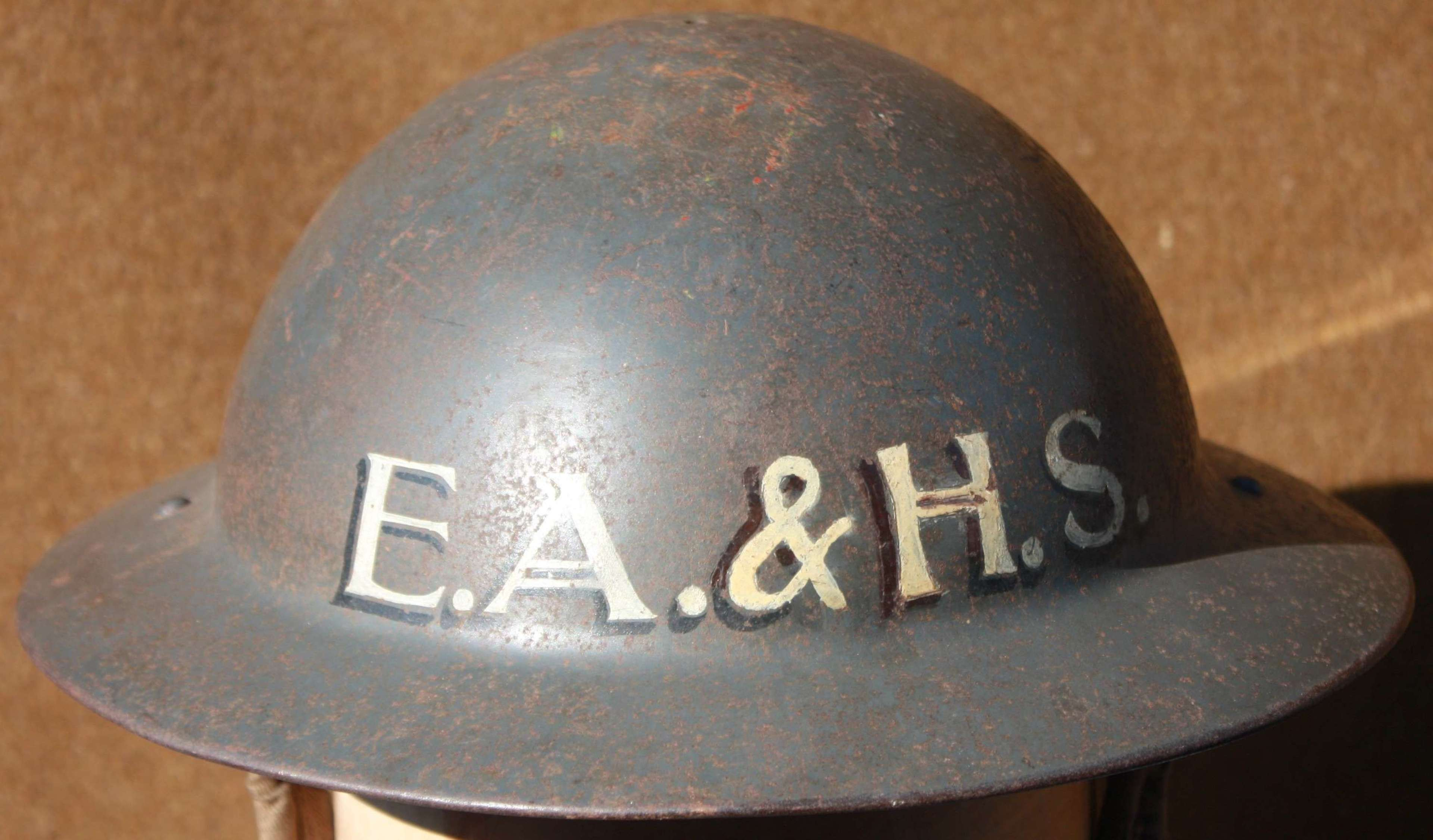 A GOOD WWII COMPANIES FIRE GUARD / ARP MEMBERS HELMET