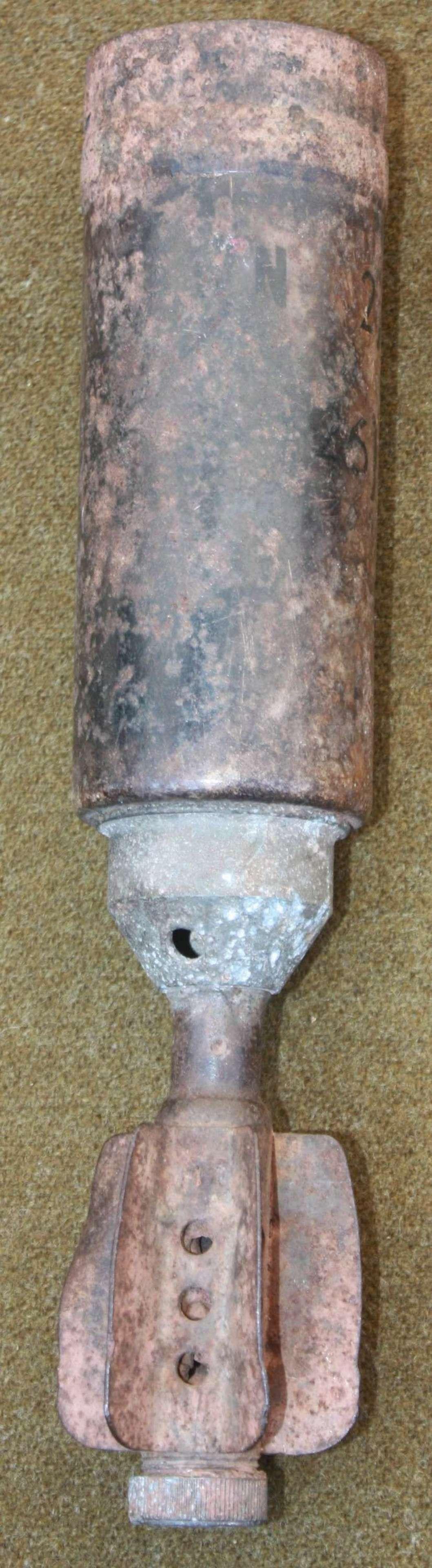 A POST WWII 1950'S 2 INCH MORTOR ROUND
