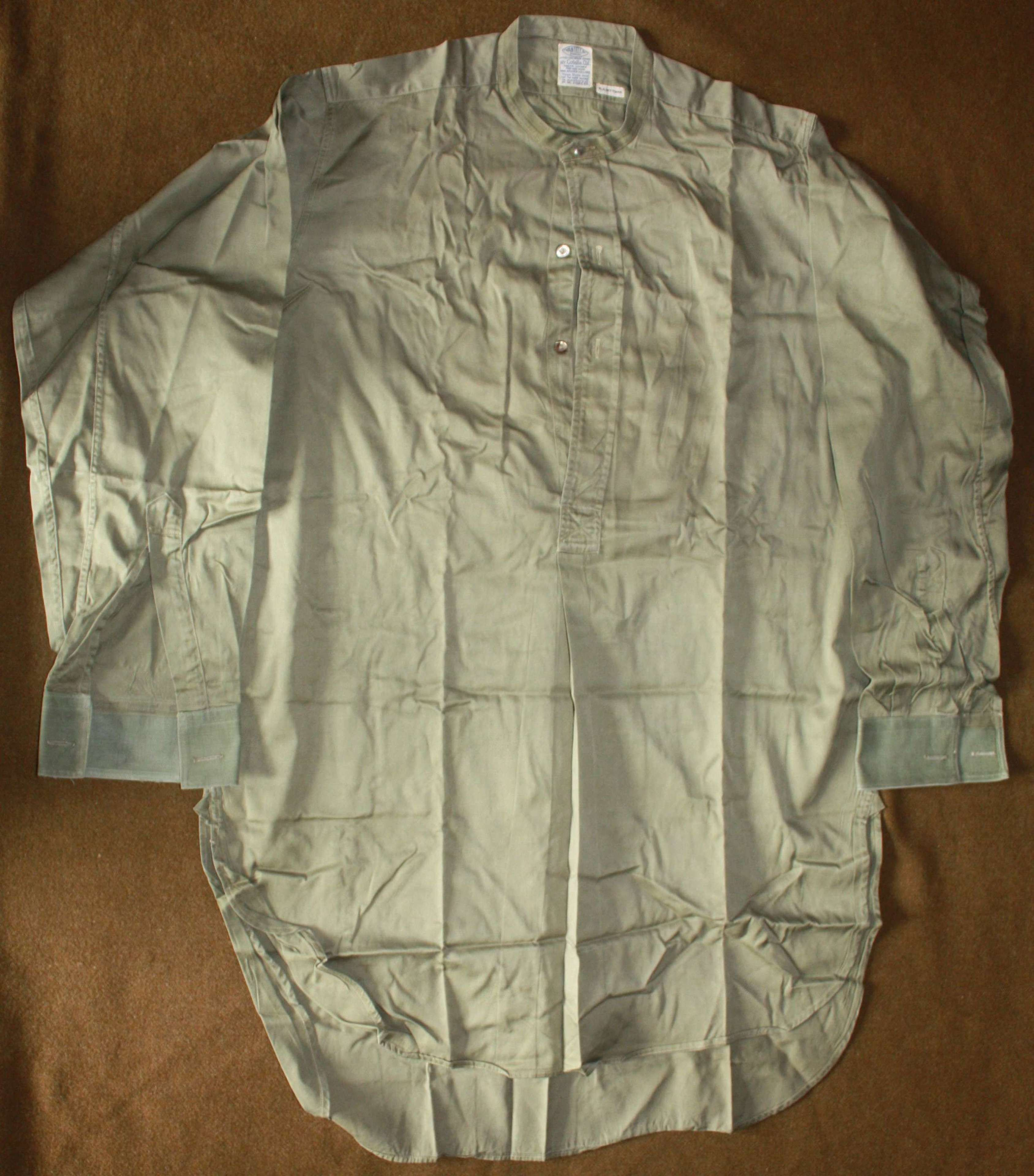 A GOOD WWII OFFICERS HALF BUTTON FRONTED SHIRT