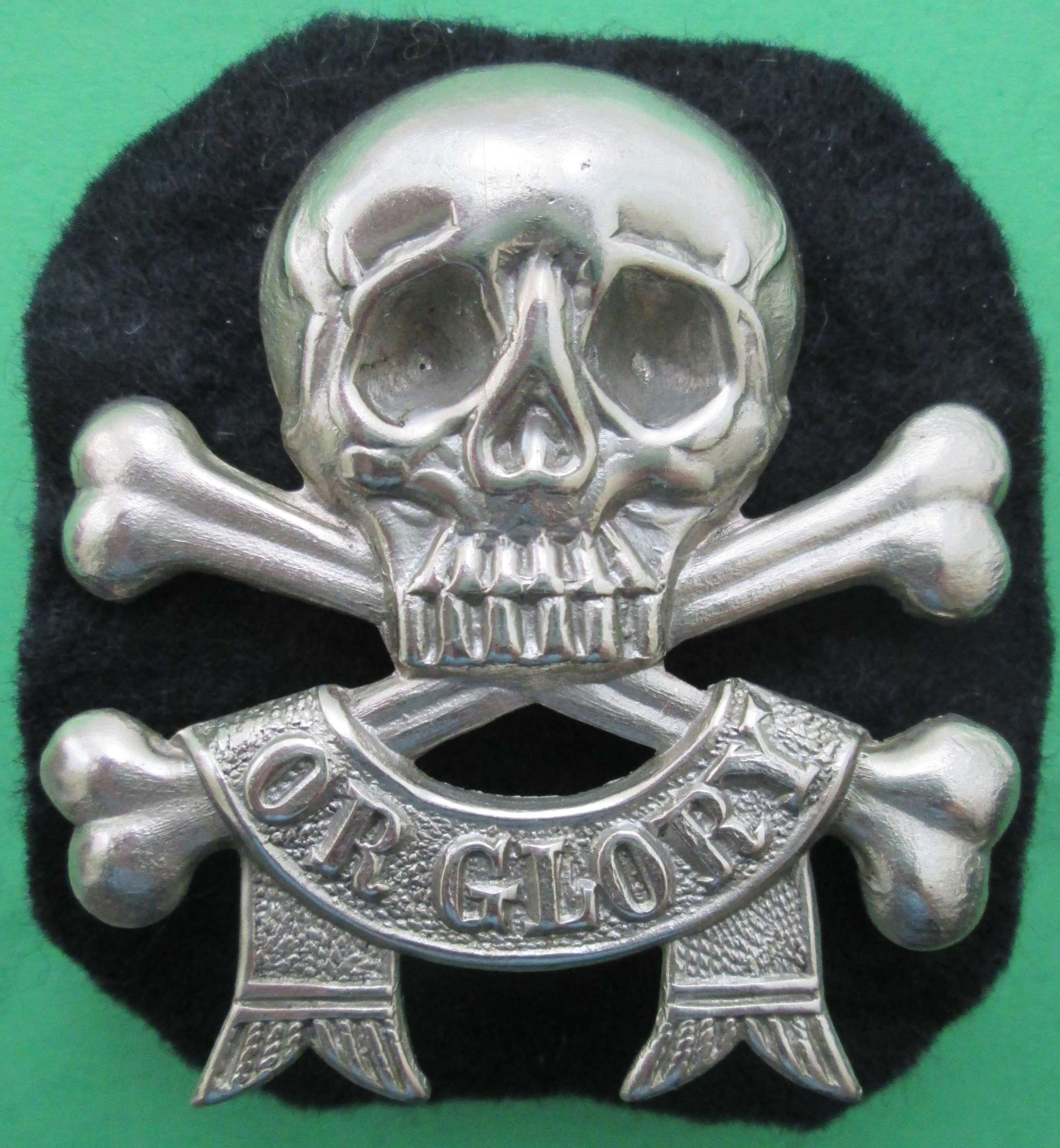 A 17/21ST LANCERS ARM  MOTTO BADGE POST 1922  EXAMPLE
