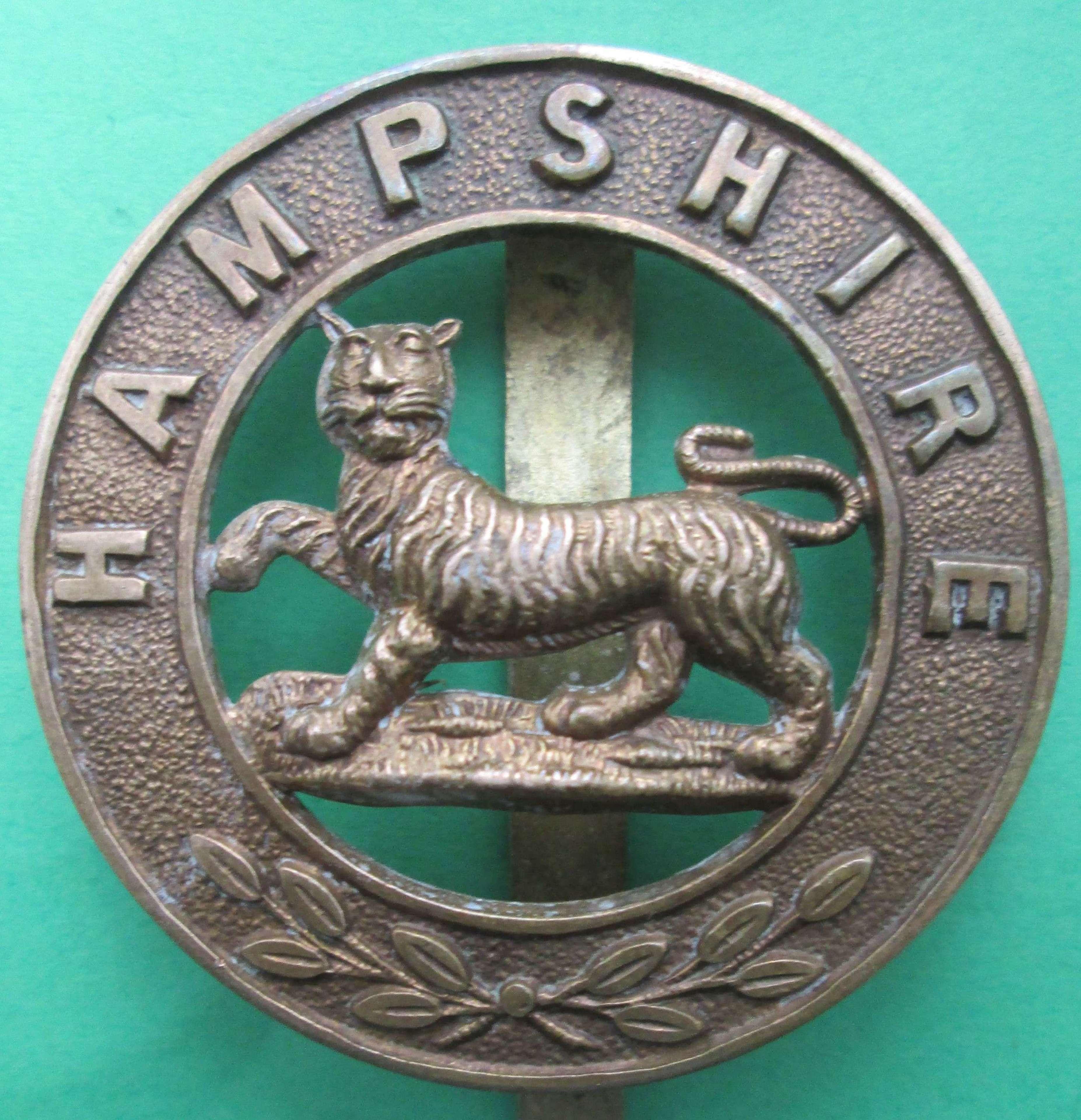 A HAMPSHIRE REGIMENT HELMET CENTRE CAP BADGE