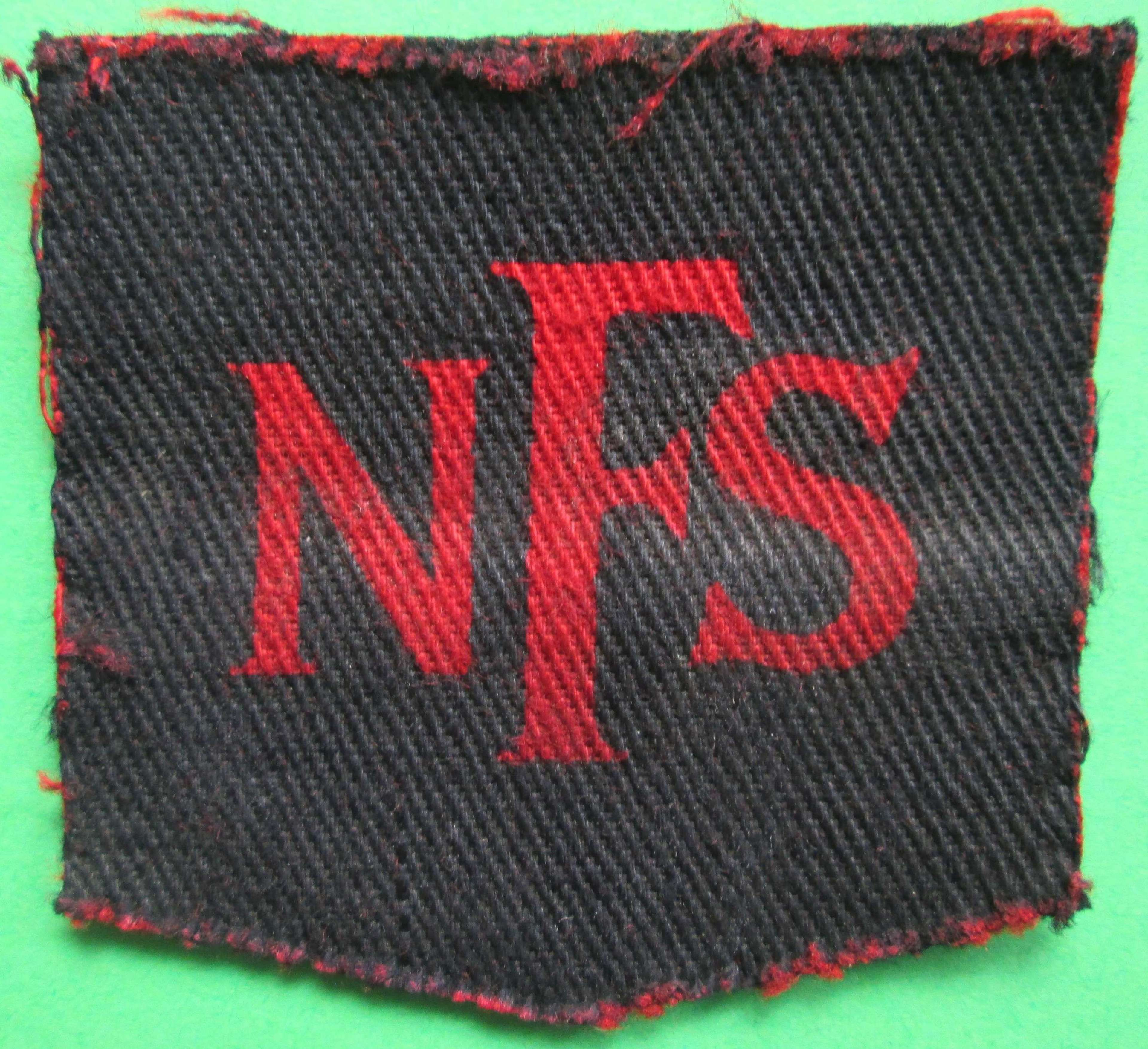 A WWII PERIOD NATIONAL FIRE SERVICE BADGE