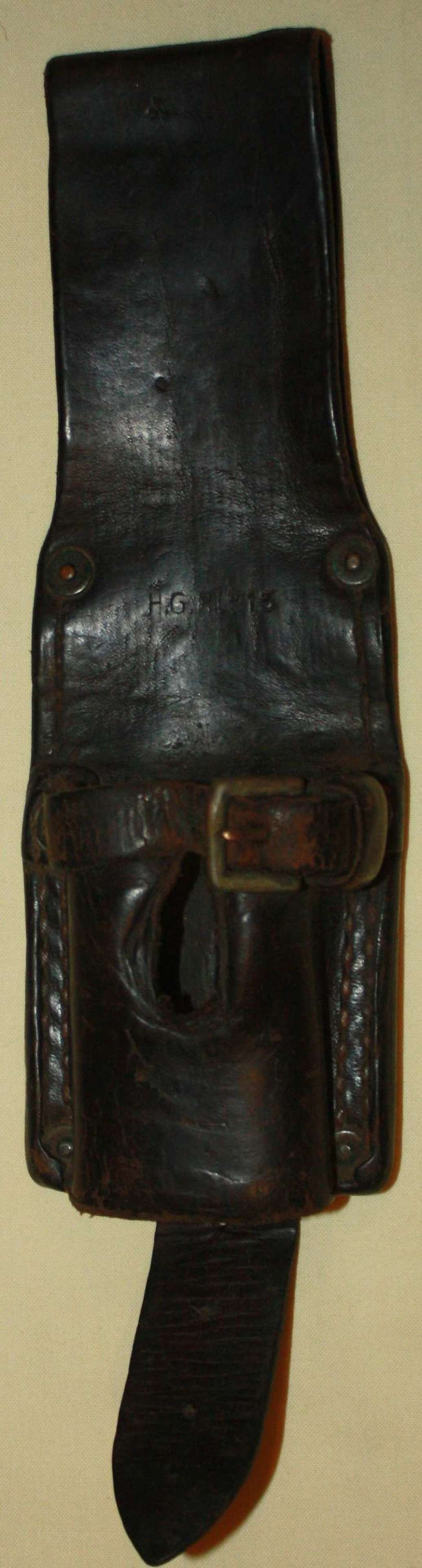 A 1915 DATED 14 PATTERN LEATHER EQUIPMENT BAYONET FROG