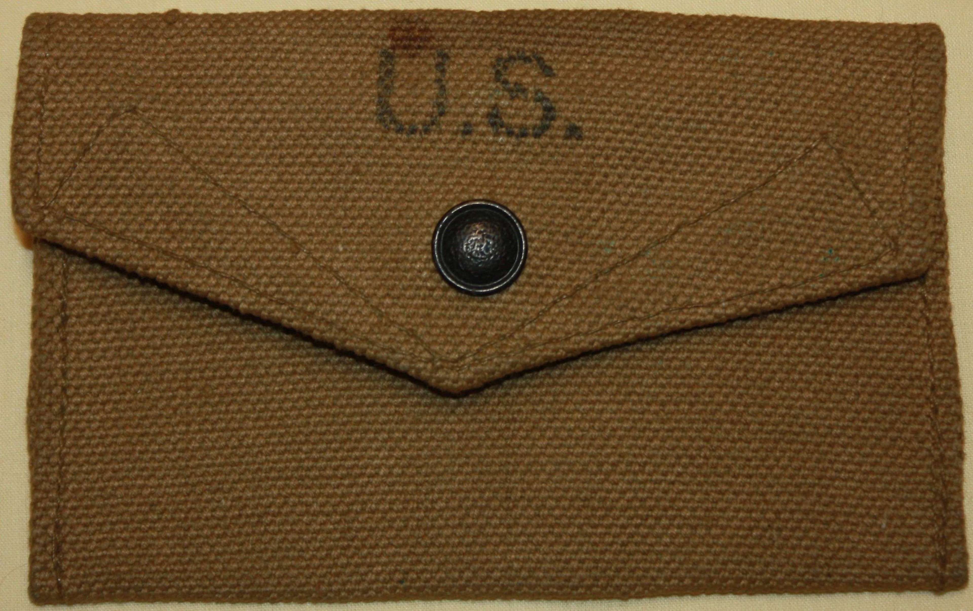 A WWII 1944 DATED BRITISH MADE ( FINNIGANS ) US FIELD DRESSING POUCH