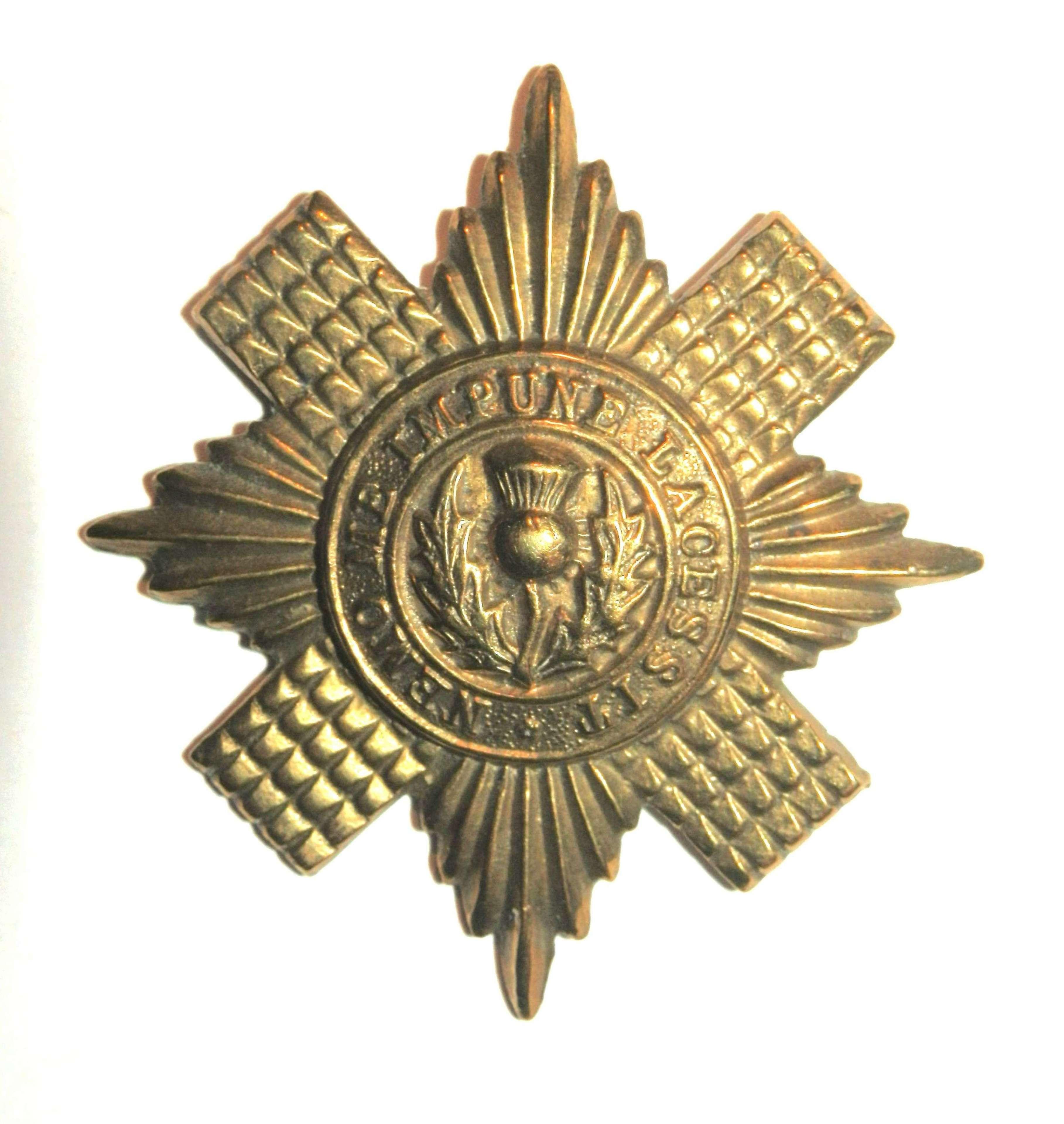 The Scots Guards Cap Badge.