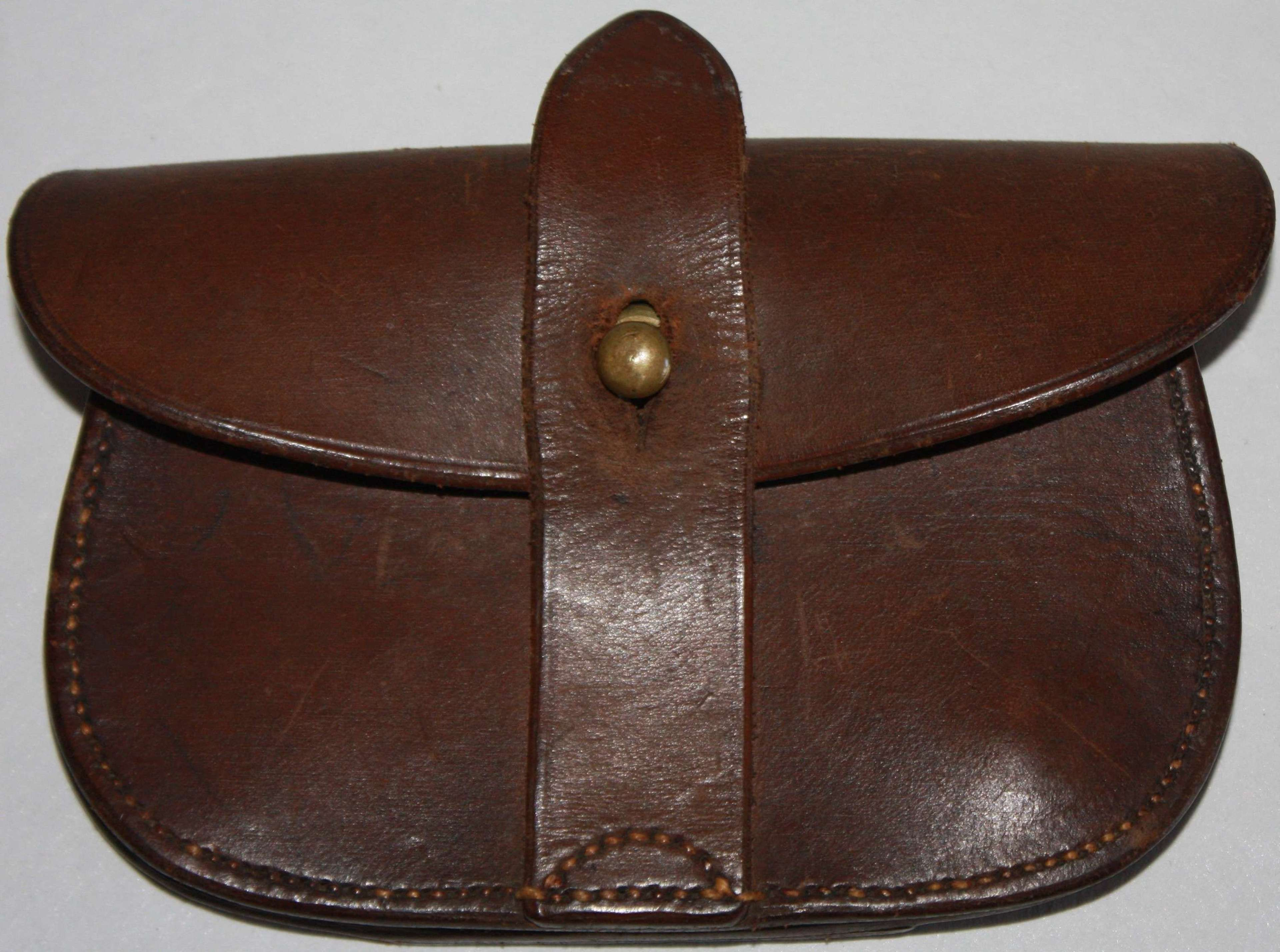 A GOOD LATE WWI INTER WAR PERIOD ISSUE SAM BROWN PISTOL AMMO POUCH