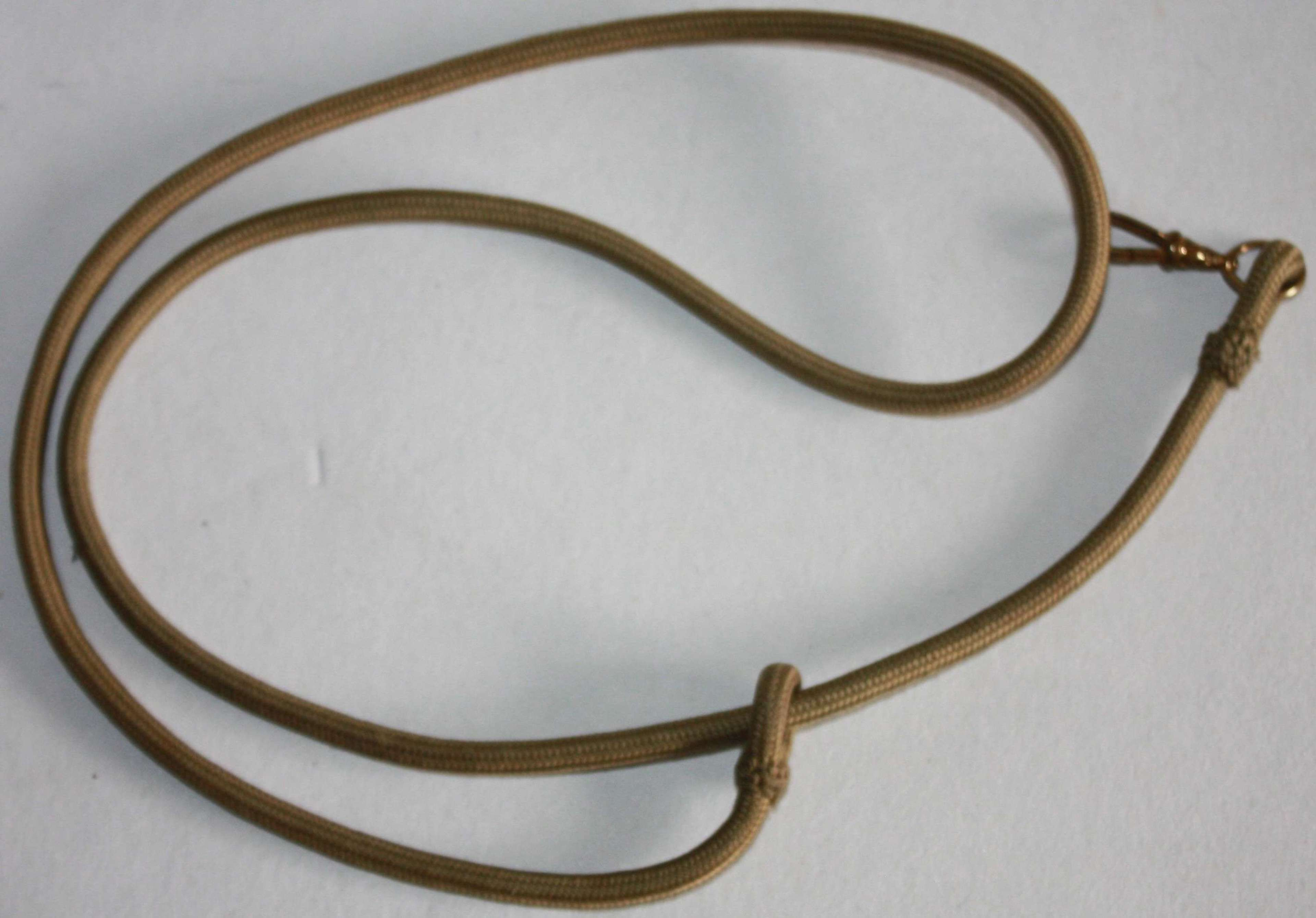A GOOD WWI / WWII OFFICERS WHISTLE LANYARD