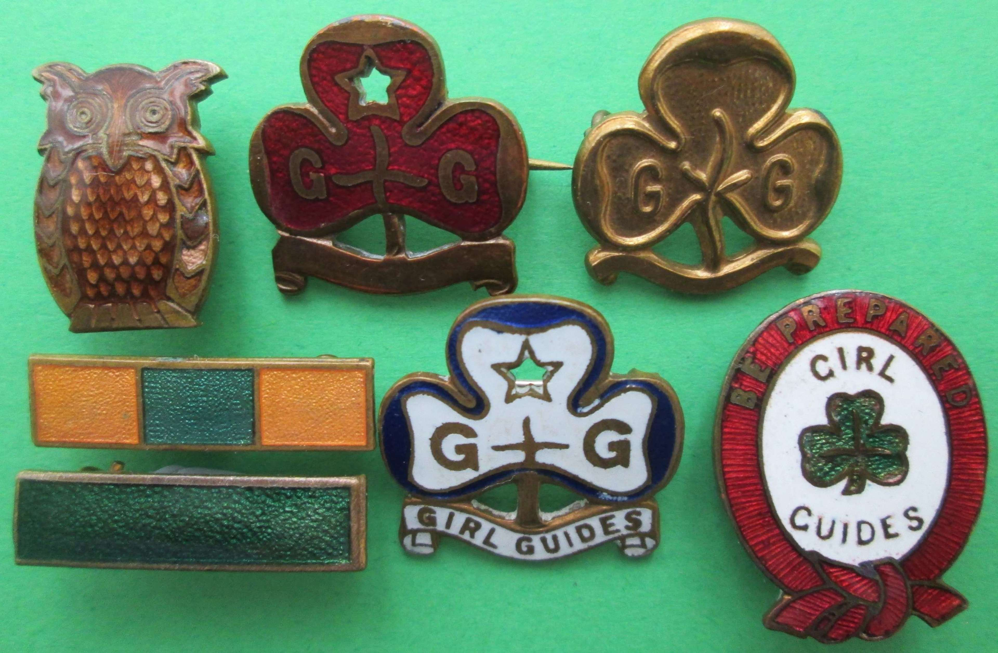 A COLLECTION OF GUIDE BADGES